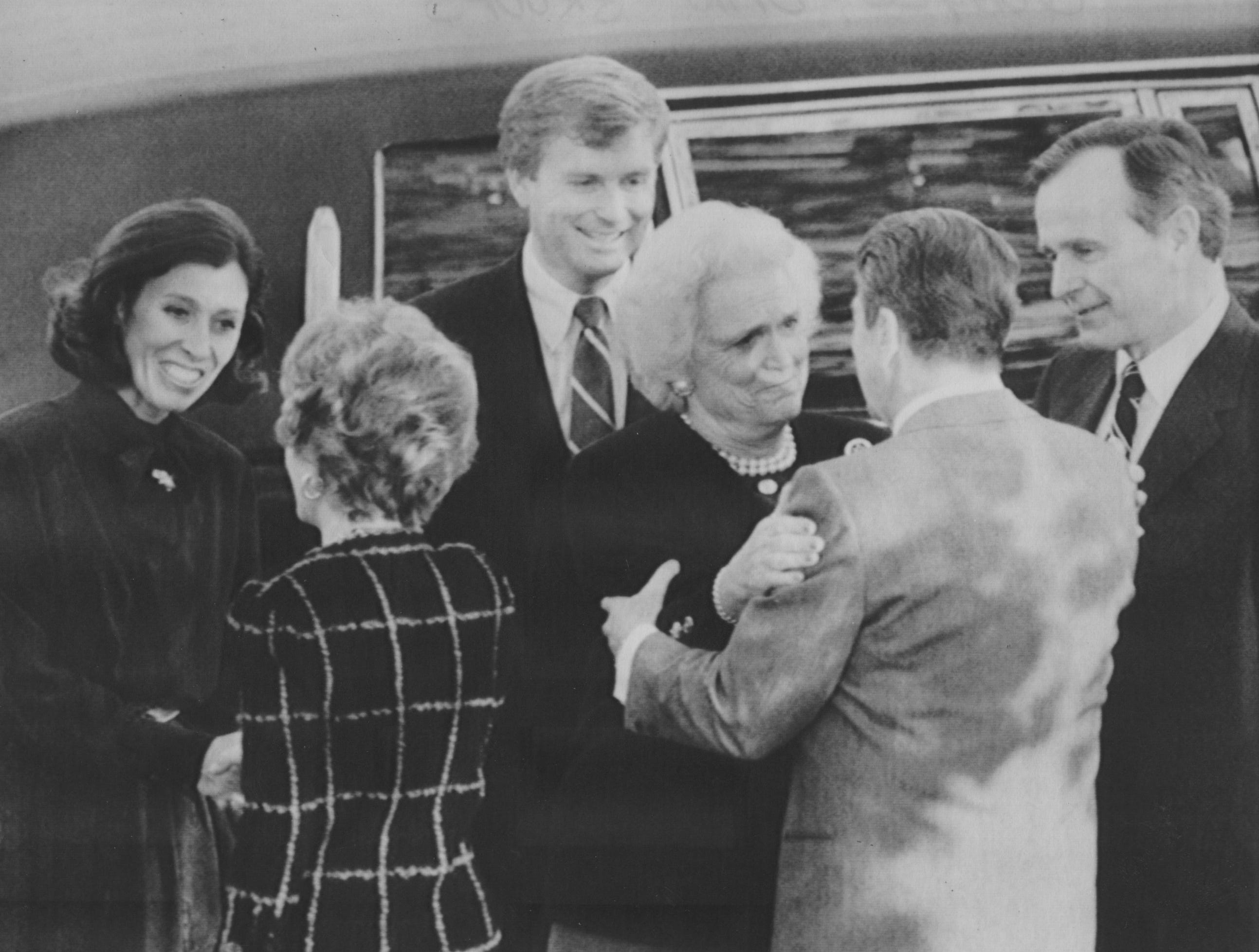 President and Mrs. Reagan greet Mrs. Bush and Mrs. Quayle as President-elect George H.W. Bush and Vice President-elect Dan Quayle look on upon their arrival at the White House on Nov. 9, 1988.