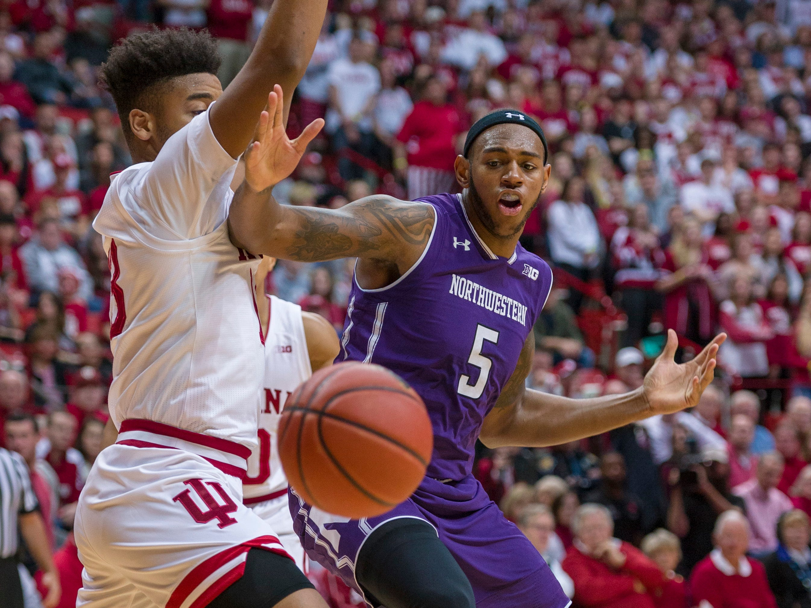 Northwestern center Dererk Pardon (5) loses the ball en route to the basket as he's defended by Indiana forward Juwan Morgan (13) during the first half of an NCAA college basketball game Saturday, Dec. 1, 2018, in Bloomington, Ind.