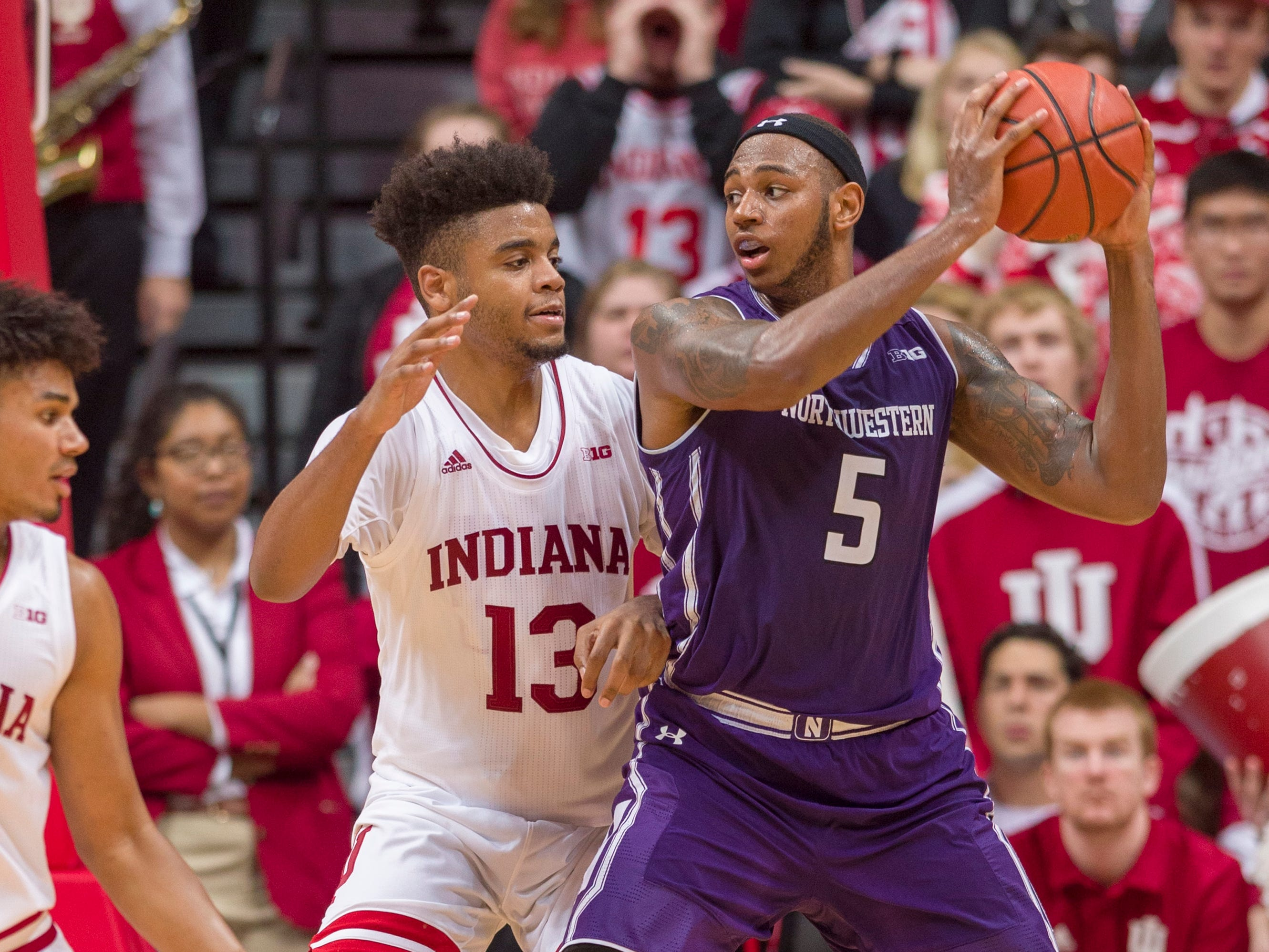 Northwestern center Dererk Pardon (5) works the ball inside against the defense of Indiana forward Juwan Morgan (13) during the second half of an NCAA college basketball game Saturday, Dec. 1, 2018, in Bloomington, Ind. Indiana won 68-66.
