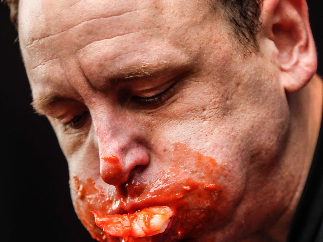 Major League Eater, Joey Chestnut competes in the sixth annual World Famous St. Elmo Shrimp Cocktail Eating Championship, held during the Meijer Tailgate Party on Georgia St. in Indianapolis on Saturday, Dec. 1, 2018. Chestnut won, setting a new world record, eating 18 pounds and 9.6 ounces of St. Elmo Shrimp Cocktail in 8 minutes.