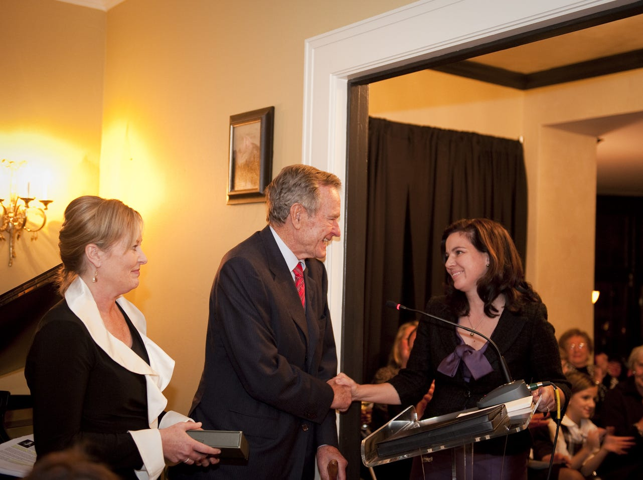 "A first edition of Booth Tarkington's first book titled ""The Gentleman from Indiana"" was presented to President Bush by Doris Anne Sadler and Becky Cook when he visited Sadler's Booth Tarkington mansion on Meridian Street on Nov. 26, 2009."