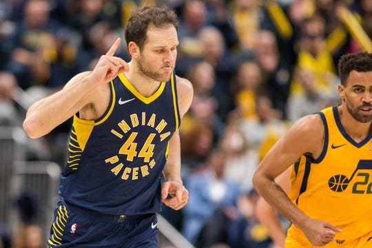 Pacers forward Bojan Bogdanovic (44) celebrates a three point basket in the second half against the Utah Jazz at Bankers Life Fieldhouse.