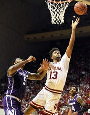 Hoosiers forward Juwan Morgan (13) makes a layup during the game against Northwestern at Simon Skjodt Assembly Hall in Bloomington, on Saturday.
