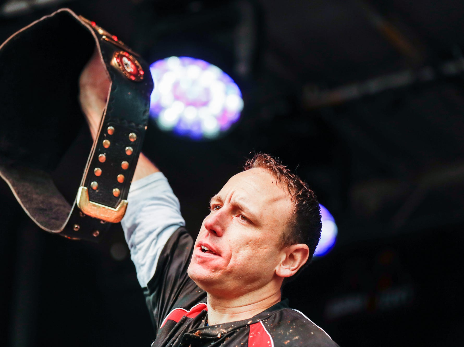 Joey Chestnut wins the sixth annual World Famous St. Elmo Shrimp Cocktail Eating Championship, held during the Meijer Tailgate Party on Georgia St. in Indianapolis on Saturday, Dec. 1, 2018. Chestnut set a new world record, eating  18 pounds and 9.6 ounces of St. Elmo Shrimp Cocktail in 8 minutes.