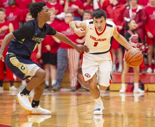 Center Grove High School senior Ben Nicoson (1) is working with basketball players around the state to raise money for the family of Rashawn Haskins, a Southport football star Killed in a car accident on Dec. 1.