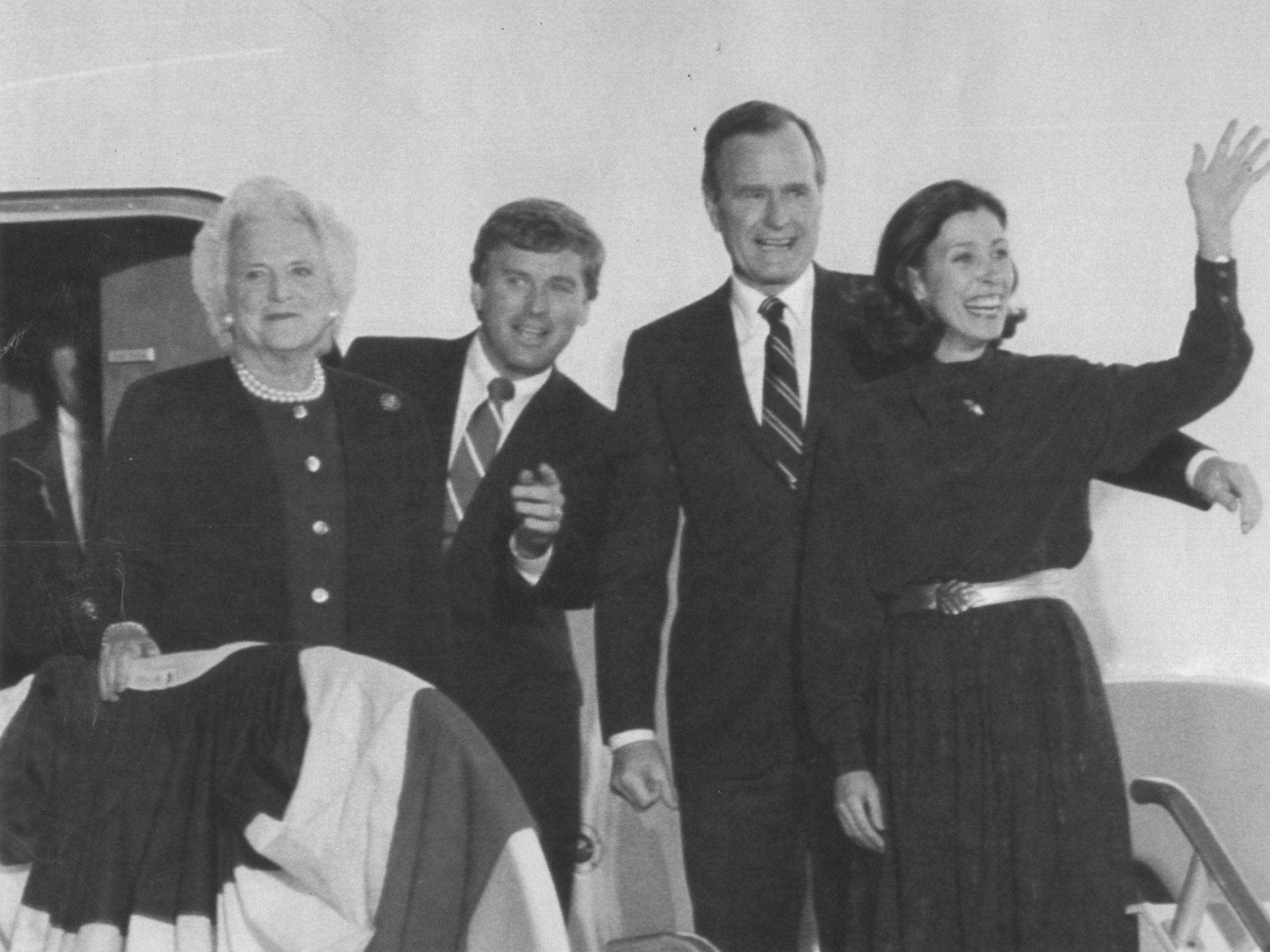 Smiles and waves greet the crowd at Andrews Air Force Base as President-elect George H.W. Bush (second from right) and his wife Barbara, left, along with Vice-President elect Dan Quayle, second from left, and his wife Marilyn, right, step off the plane on Nov. 9, 1988.