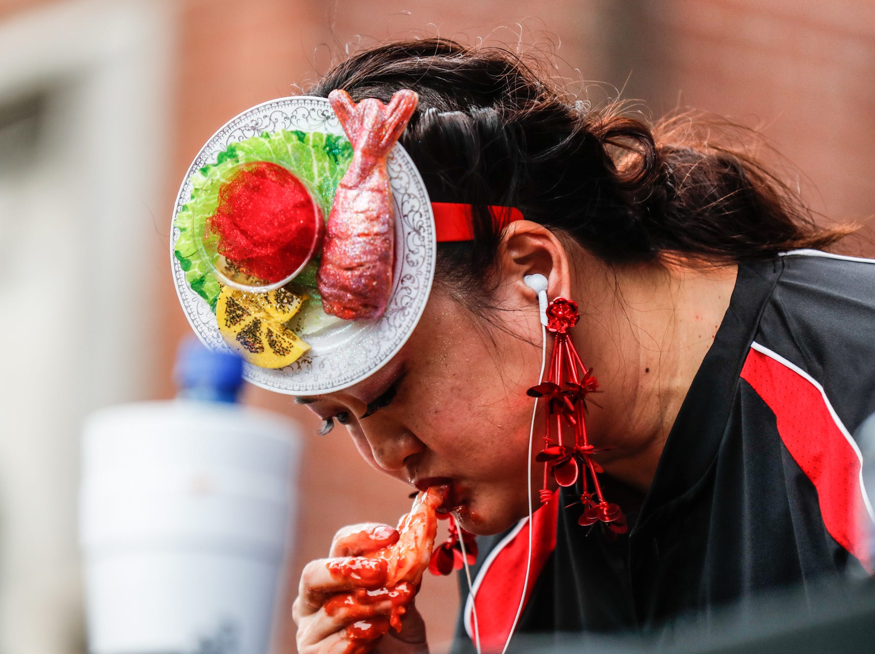 Major League Eater, Mary Bowers competes in the sixth annual World Famous St. Elmo Shrimp Cocktail Eating Championship, held during the Meijer Tailgate Party on Georgia St. in Indianapolis on Saturday, Dec. 1, 2018.