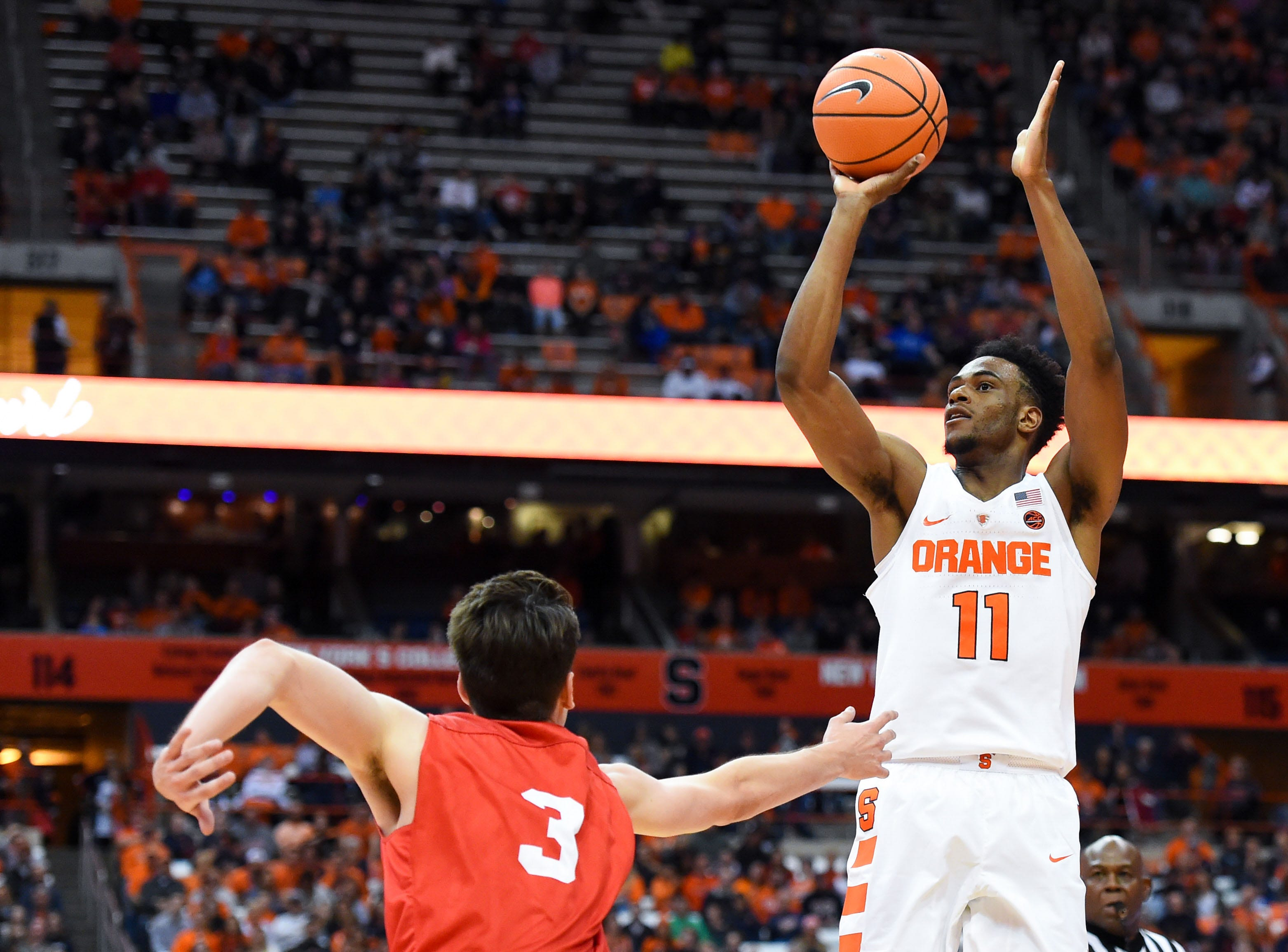 Nov 10, 2017; Syracuse, NY, USA; Syracuse Orange forward Oshae Brissett (11) shoots the ball over Cornell Big Red forward Jimmy Boeheim (3) during the second half at the Carrier Dome. Mandatory Credit: Rich Barnes-USA TODAY Sports