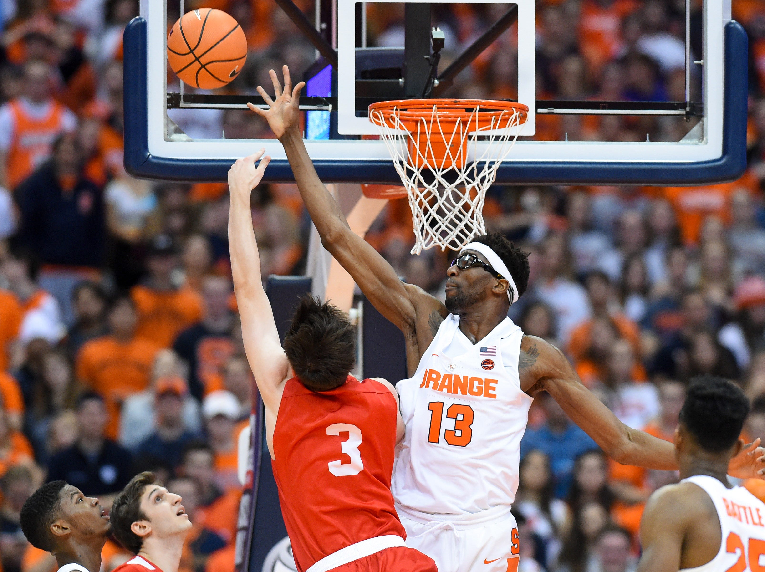Nov 10, 2017; Syracuse, NY, USA; Syracuse Orange center Paschal Chukwu (13) alters the shot of Cornell Big Red forward Jimmy Boeheim (3) during the first half at the Carrier Dome. Mandatory Credit: Rich Barnes-USA TODAY Sports