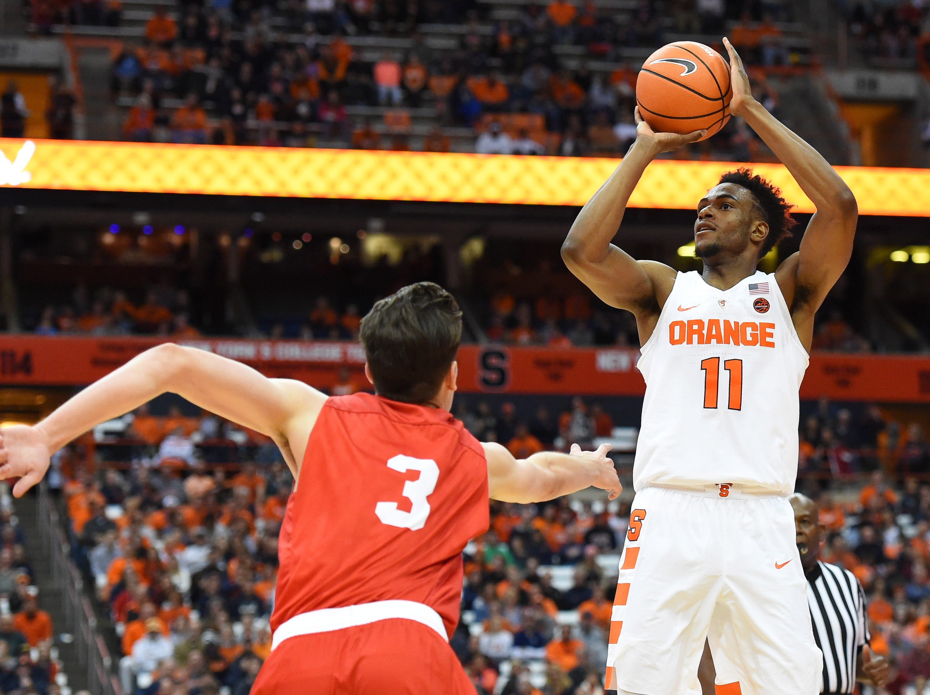 Nov 10, 2017; Syracuse, NY, USA; Syracuse Orange forward Oshae Brissett (11) shoots the ball as Cornell Big Red forward Jimmy Boeheim (3) defends during the second half at the Carrier Dome. Mandatory Credit: Rich Barnes-USA TODAY Sports