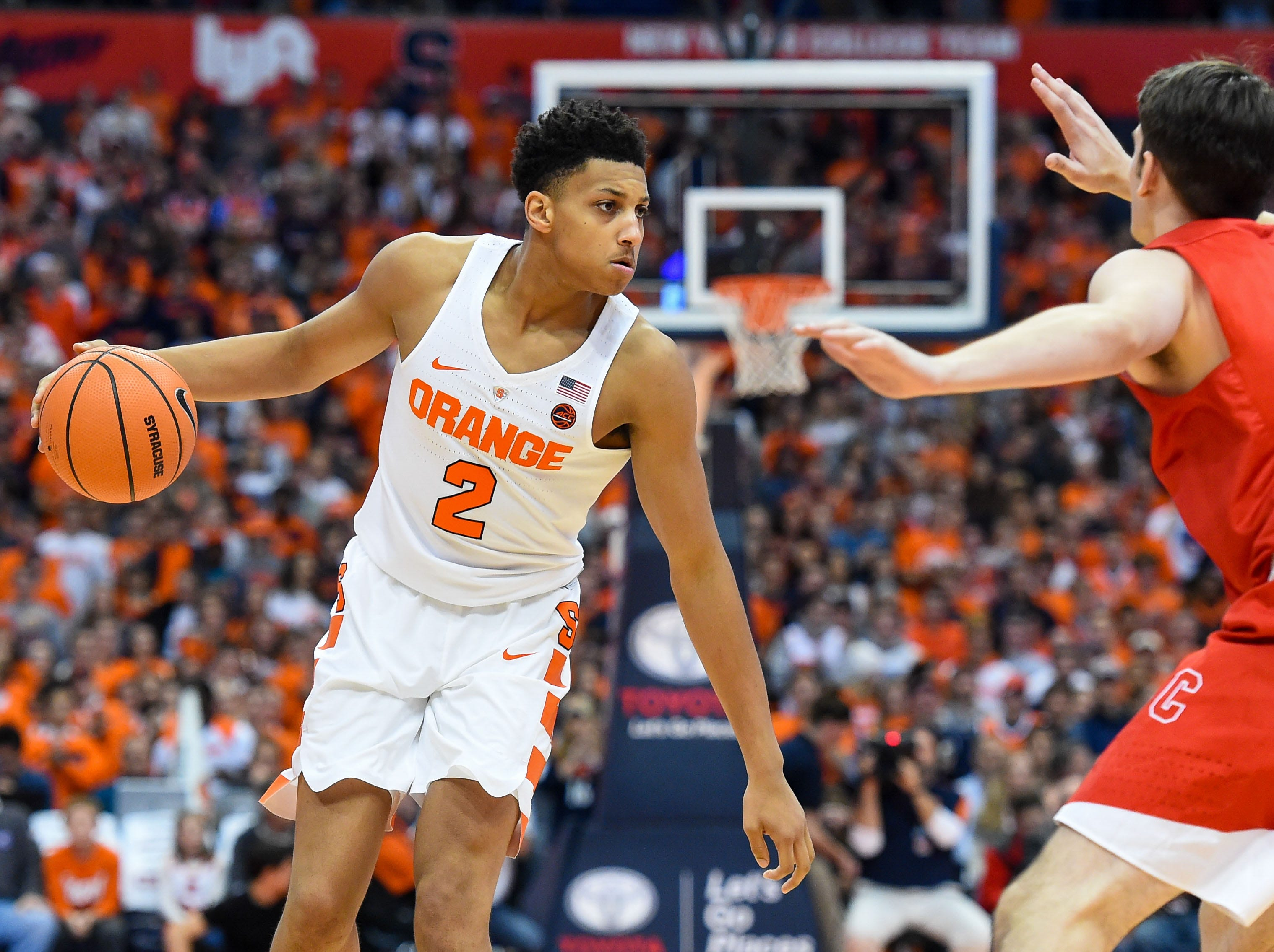 Nov 10, 2017; Syracuse, NY, USA; Syracuse Orange forward Matthew Moyer (2) controls the ball as Cornell Big Red forward Jimmy Boeheim (3) defends during the first half at the Carrier Dome. Mandatory Credit: Rich Barnes-USA TODAY Sports