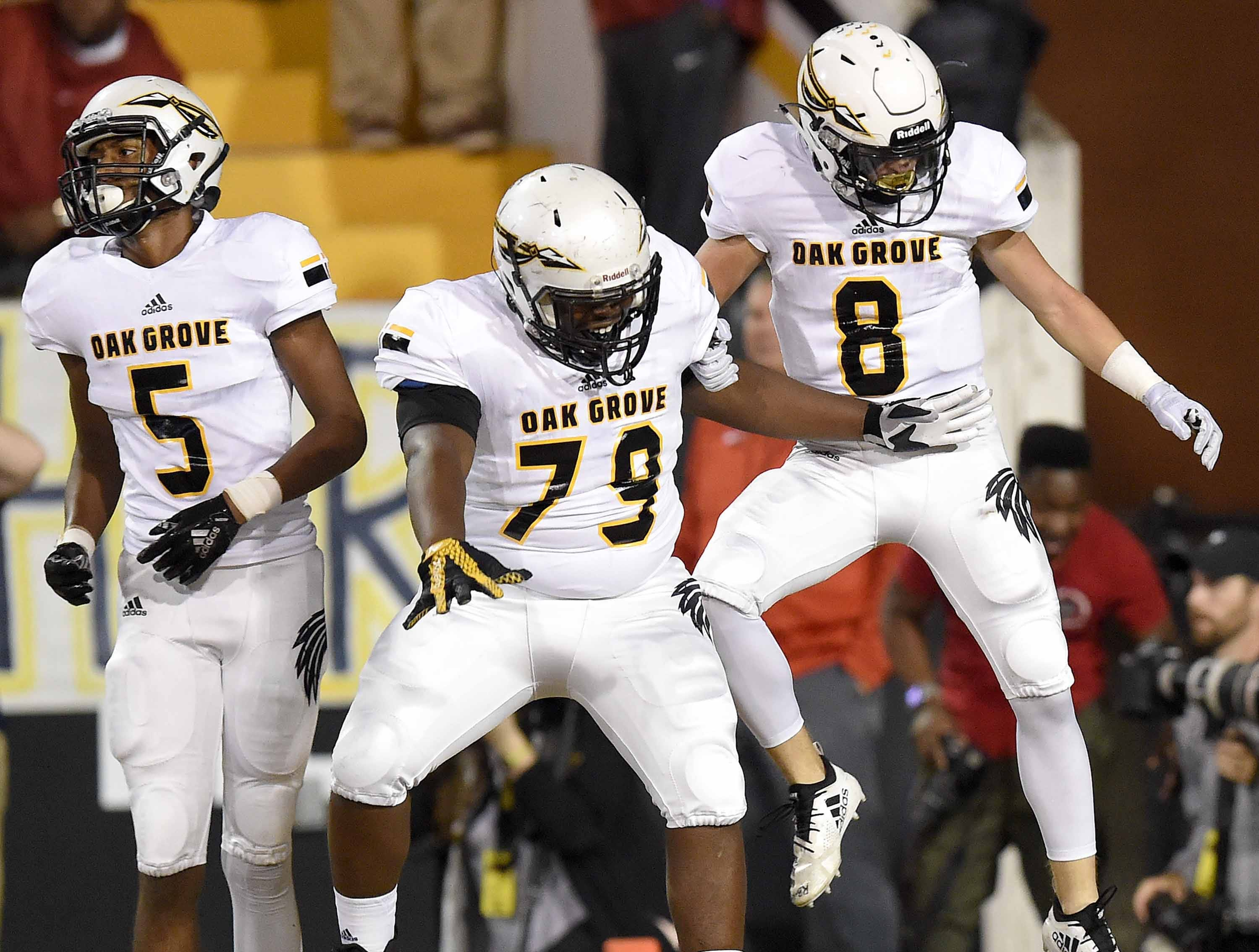 Oak Grove's Liam Breighaupt (8) celebrates against Horn Lake with Taurese Sibley (79) and Tavion Smith (5) on Friday, November 20, 2018, in the MHSAA BlueCross BlueShield Gridiron Classic High School Football Championships in M.M. Roberts Stadium on the University of Southern Mississippi campus in Hattiesburg, Miss.