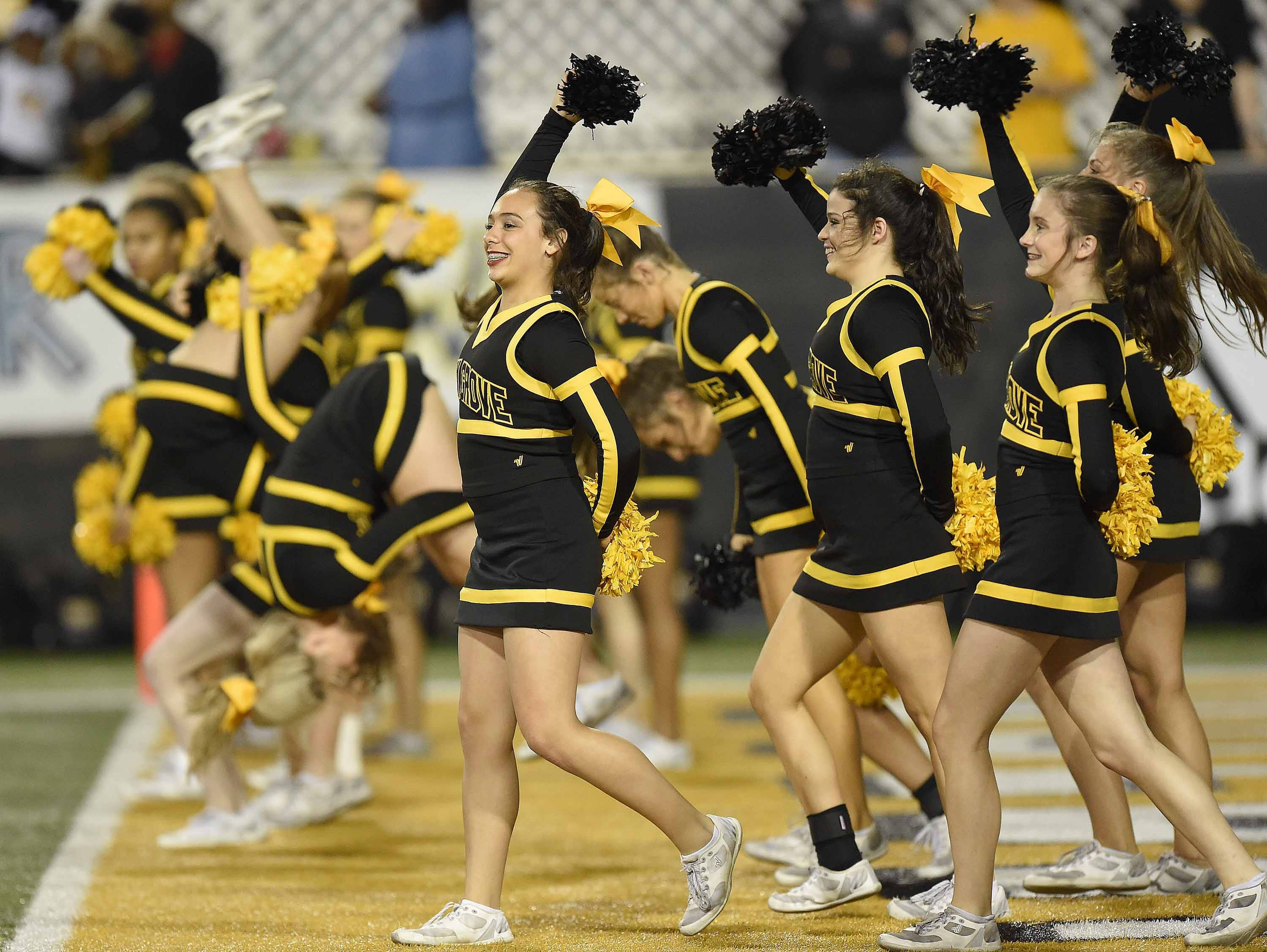 The Oak Grove cheerleaders do back flips to celebrate a Warriors touchdown on Friday, November 20, 2018, in the MHSAA BlueCross BlueShield Gridiron Classic High School Football Championships in M.M. Roberts Stadium on the University of Southern Mississippi campus in Hattiesburg, Miss.