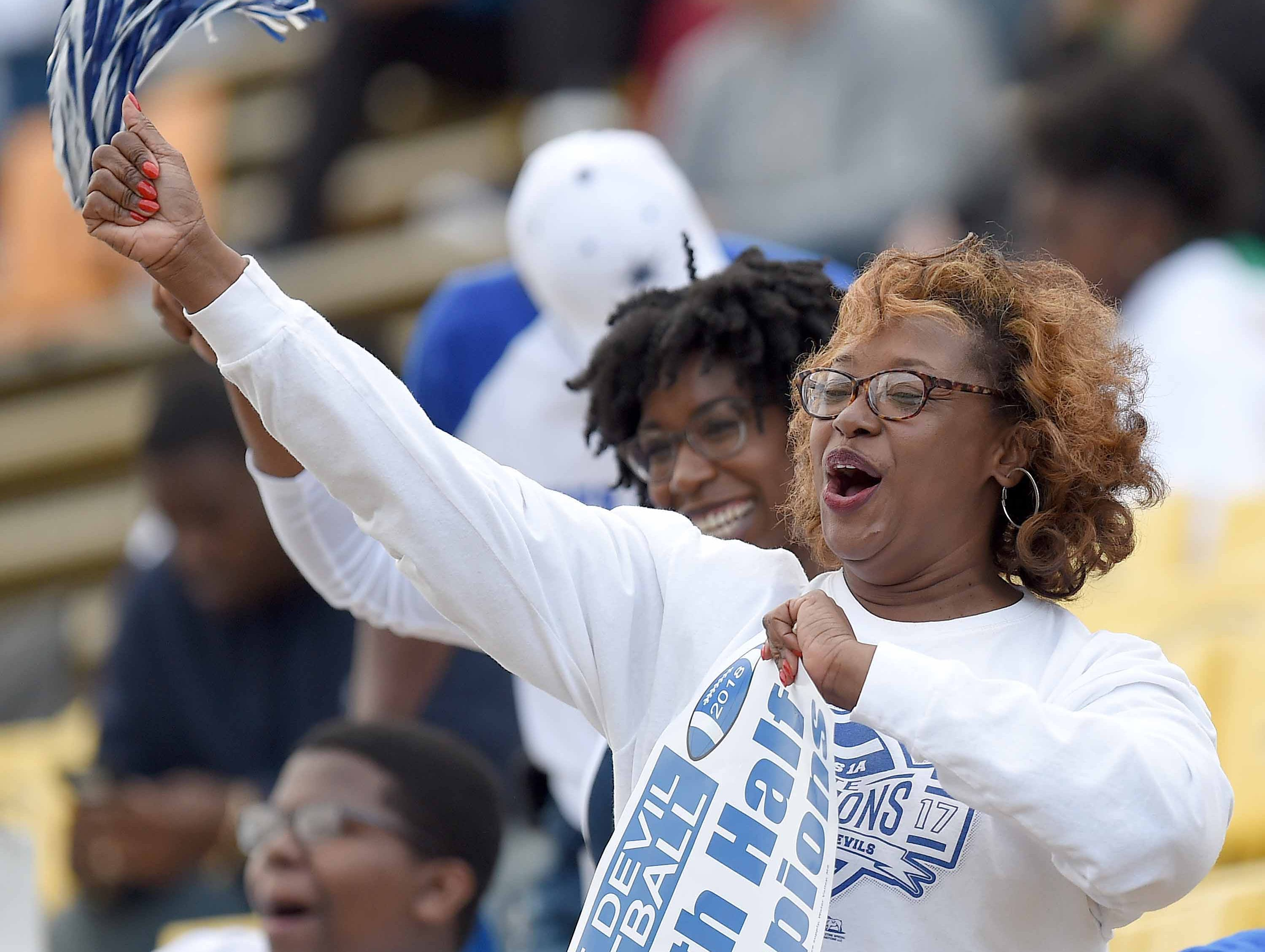 A Hollandale Simmons fan cheers for her Blue Devils on Friday, November 20, 2018, in the MHSAA BlueCross BlueShield Gridiron Classic High School Football Championships in M.M. Roberts Stadium on the University of Southern Mississippi campus in Hattiesburg, Miss.