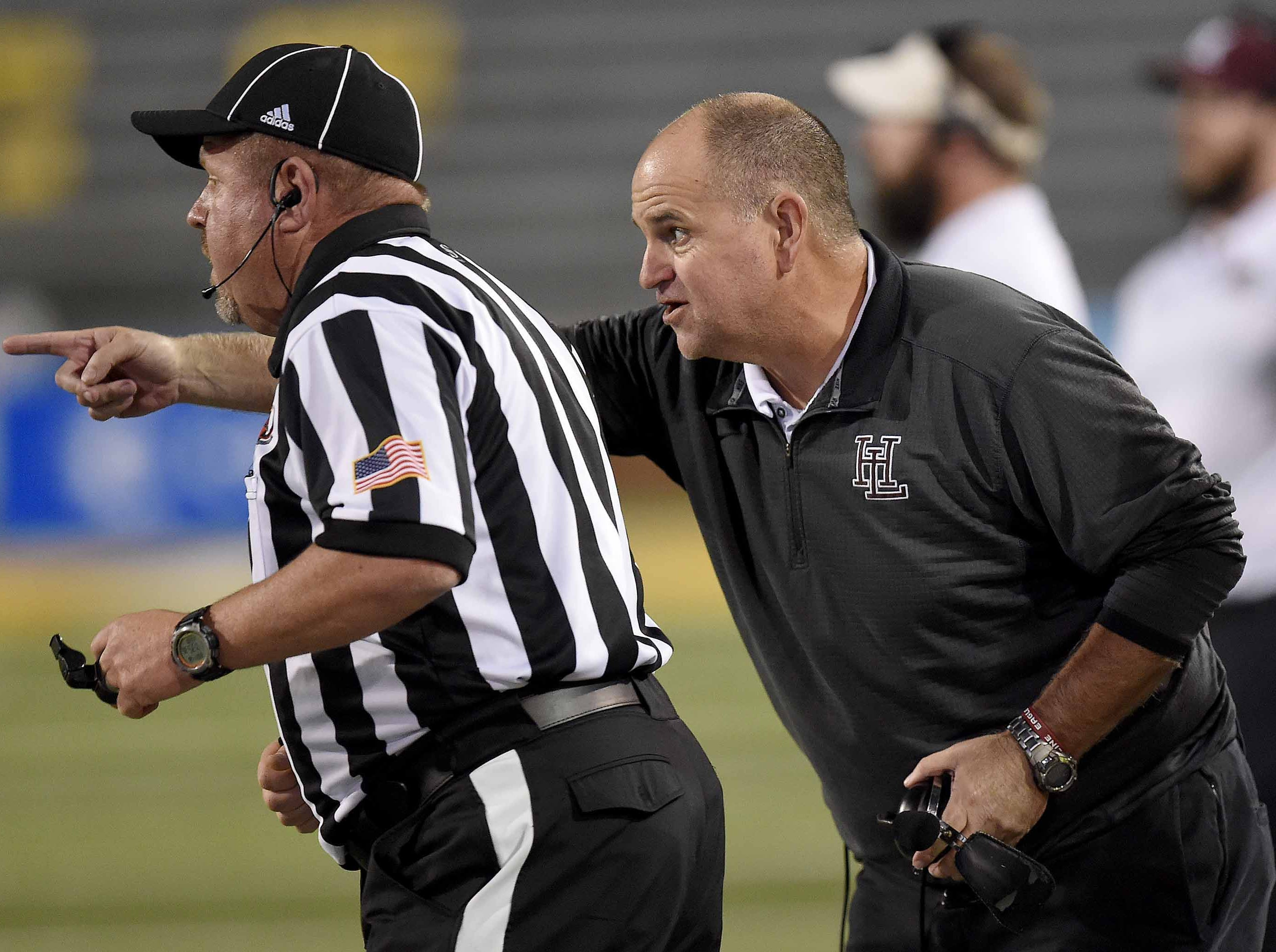 Horn Lake head coach Brad Boyette lobbies an official on Friday, November 20, 2018, in the MHSAA BlueCross BlueShield Gridiron Classic High School Football Championships in M.M. Roberts Stadium on the University of Southern Mississippi campus in Hattiesburg, Miss.