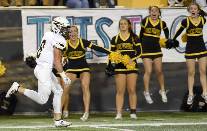 Oak Grove's Liam Breighaupt (8) heads for a touchdown against Horn Lake as the cheerleaders react on the sideline on Friday, November 20, 2018, in the MHSAA BlueCross BlueShield Gridiron Classic High School Football Championships in M.M. Roberts Stadium on the University of Southern Mississippi campus in Hattiesburg, Miss.