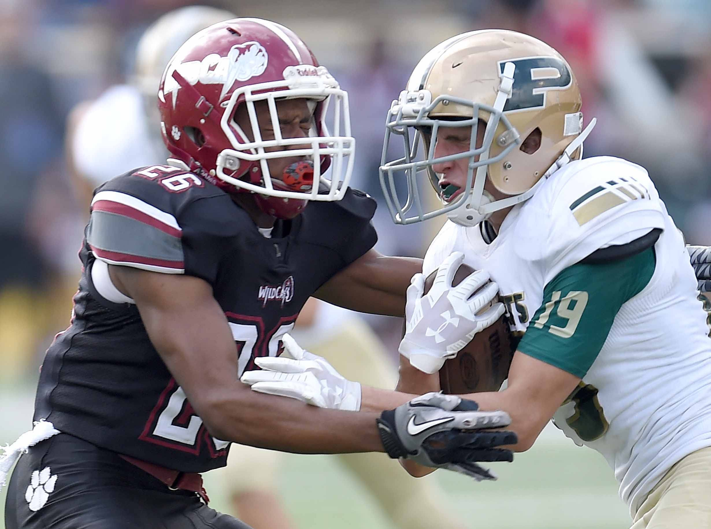 Poplarville's Casin Sones (19) returns a punt against Louisville's Keandre Gill (26) on Saturday, December 1, 2018, in the MHSAA BlueCross BlueShield Gridiron Classic High School Football Championships in M.M. Roberts Stadium on the University of Southern Mississippi campus in Hattiesburg, Miss.