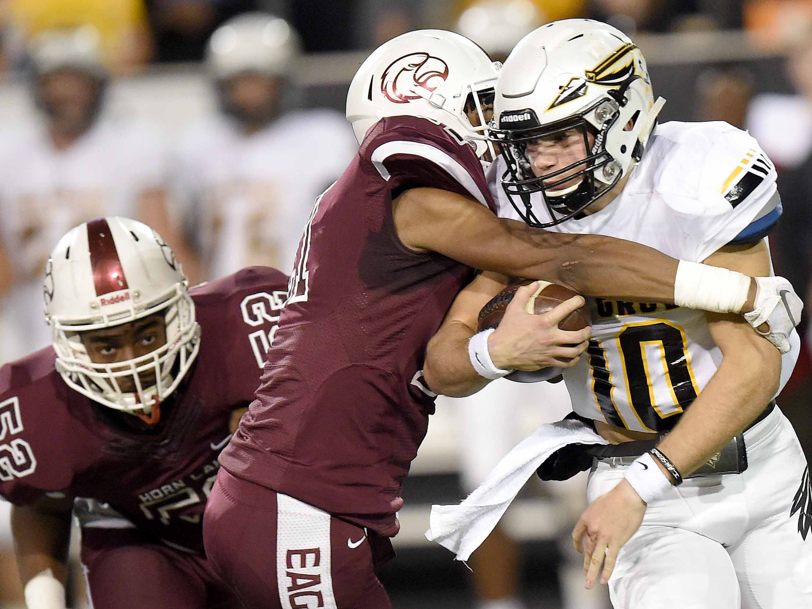 Oak Grove's John Rhys Plumlee (10) runs the ball against Horn Lake on Friday, November 20, 2018, in the MHSAA BlueCross BlueShield Gridiron Classic High School Football Championships in M.M. Roberts Stadium on the University of Southern Mississippi campus in Hattiesburg, Miss.