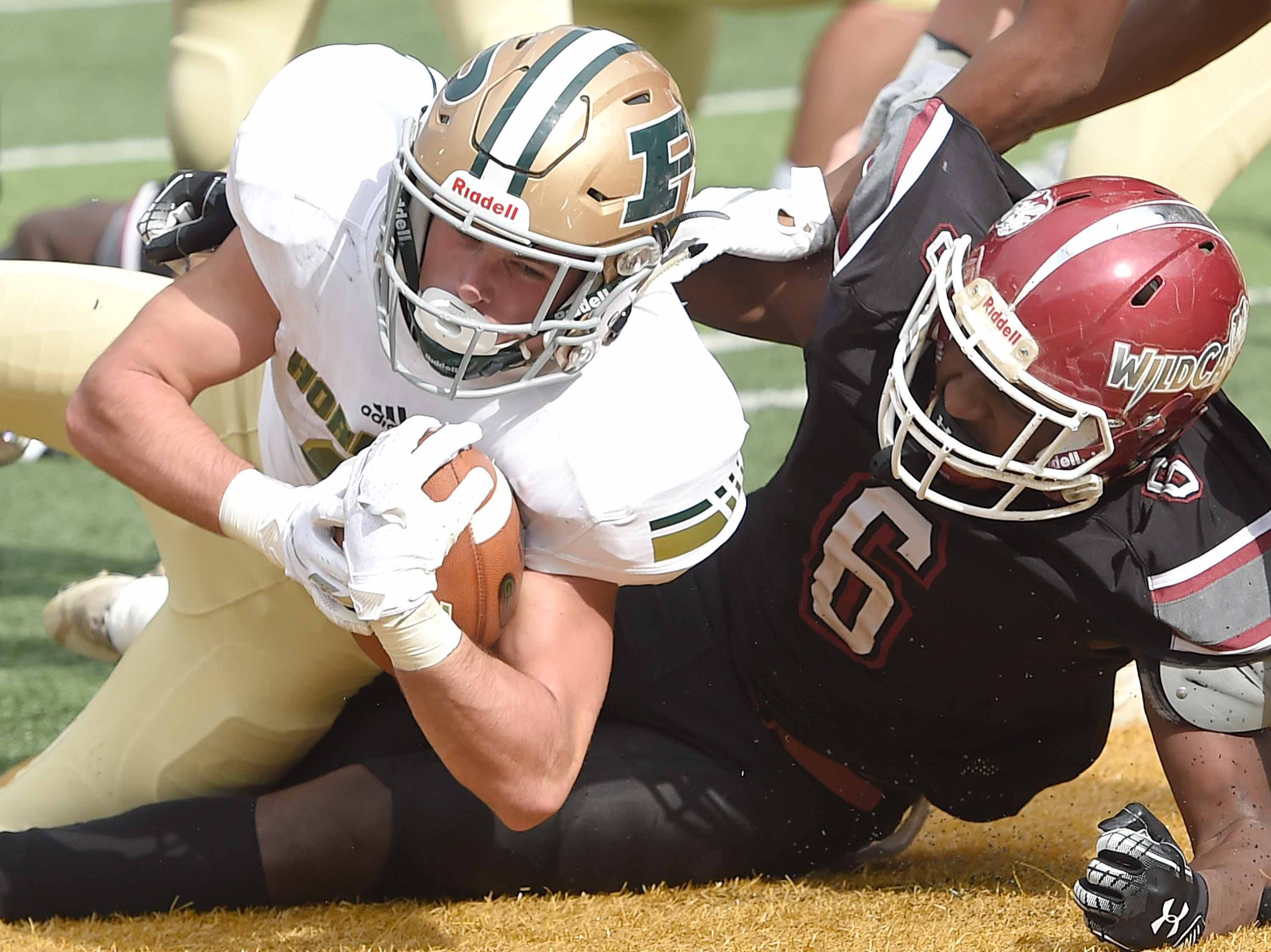 Poplarville's Tyson Holston (left) scores his second of three touchdowns against Louisville on Saturday, December 1, 2018, in the MHSAA BlueCross BlueShield Gridiron Classic High School Football Championships in M.M. Roberts Stadium on the University of Southern Mississippi campus in Hattiesburg, Miss.
