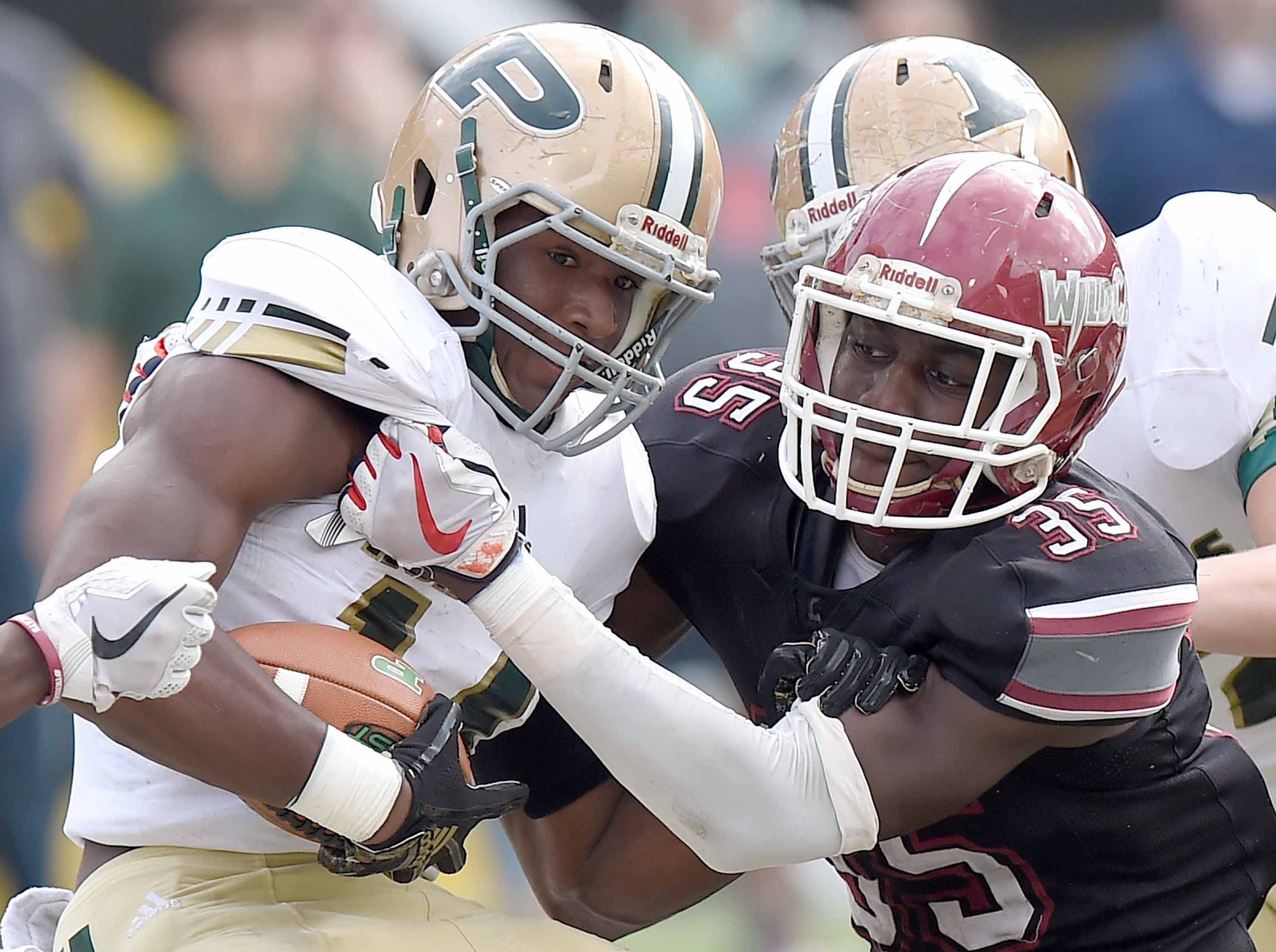 Louisville's Ashanti Cistrunk (35) tackles Poplarville's Chase Shears on Saturday, December 1, 2018, in the MHSAA BlueCross BlueShield Gridiron Classic High School Football Championships in M.M. Roberts Stadium on the University of Southern Mississippi campus in Hattiesburg, Miss.