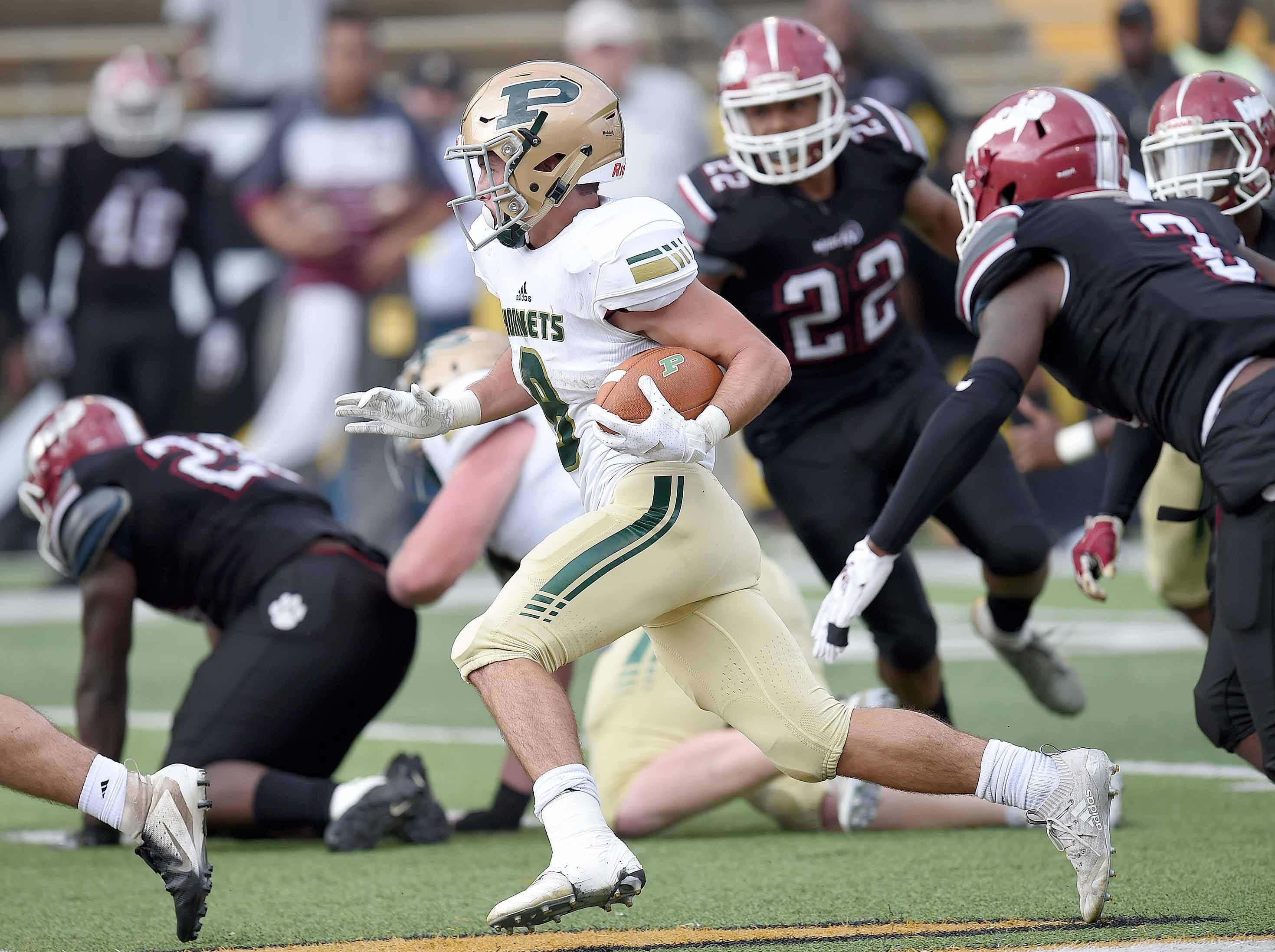 Poplarville's Tyson Holston (left) runs through the Louisville defense on Saturday, December 1, 2018, in the MHSAA BlueCross BlueShield Gridiron Classic High School Football Championships in M.M. Roberts Stadium on the University of Southern Mississippi campus in Hattiesburg, Miss.