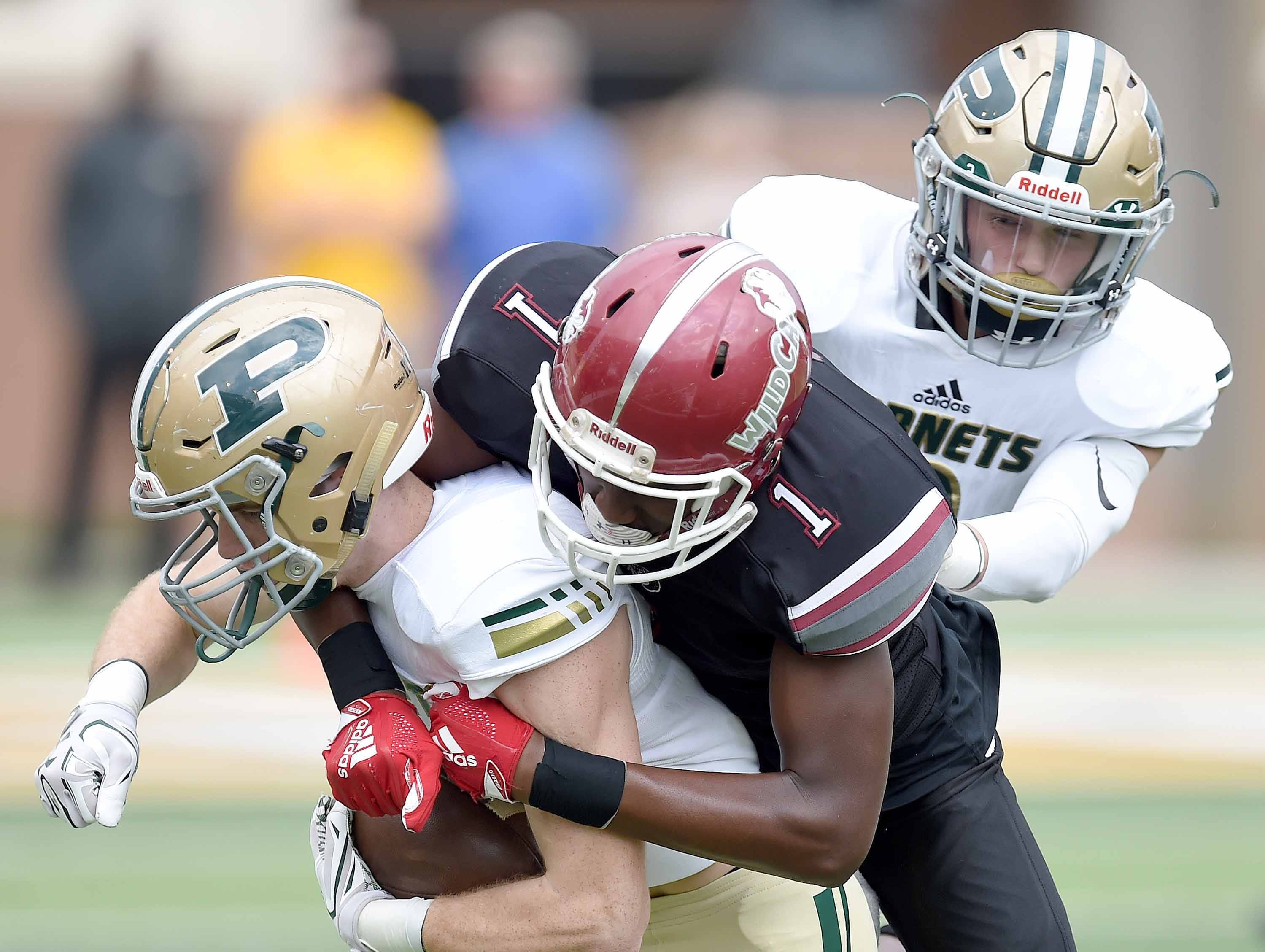 Poplarville's Canaan Ray (left) is tackled by Louisville's Alvius Haynes (1) after intercepting a pass on Saturday, December 1, 2018, in the MHSAA BlueCross BlueShield Gridiron Classic High School Football Championships in M.M. Roberts Stadium on the University of Southern Mississippi campus in Hattiesburg, Miss.