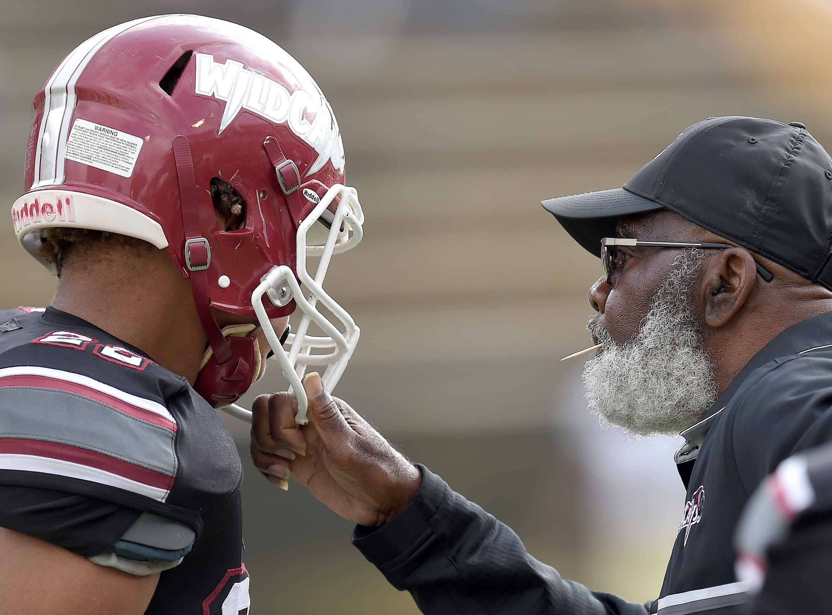 Louisville head coach M.C. Miller gets the attention of one of his players during a time out on Saturday, December 1, 2018, in the MHSAA BlueCross BlueShield Gridiron Classic High School Football Championships in M.M. Roberts Stadium on the University of Southern Mississippi campus in Hattiesburg, Miss.