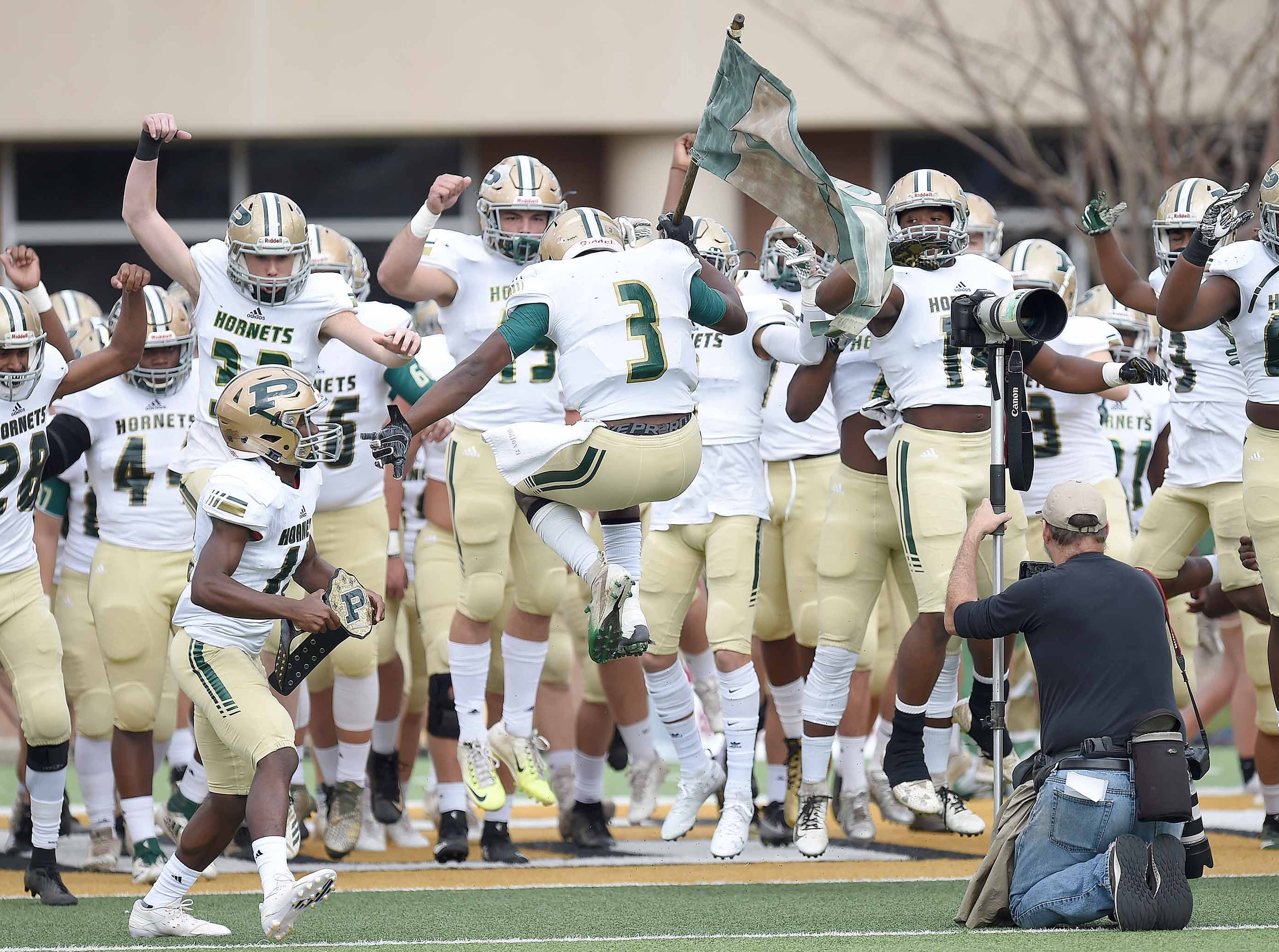 The Poplarville Hornets prepare to take the field on Saturday, December 1, 2018, in the MHSAA BlueCross BlueShield Gridiron Classic High School Football Championships in M.M. Roberts Stadium on the University of Southern Mississippi campus in Hattiesburg, Miss.