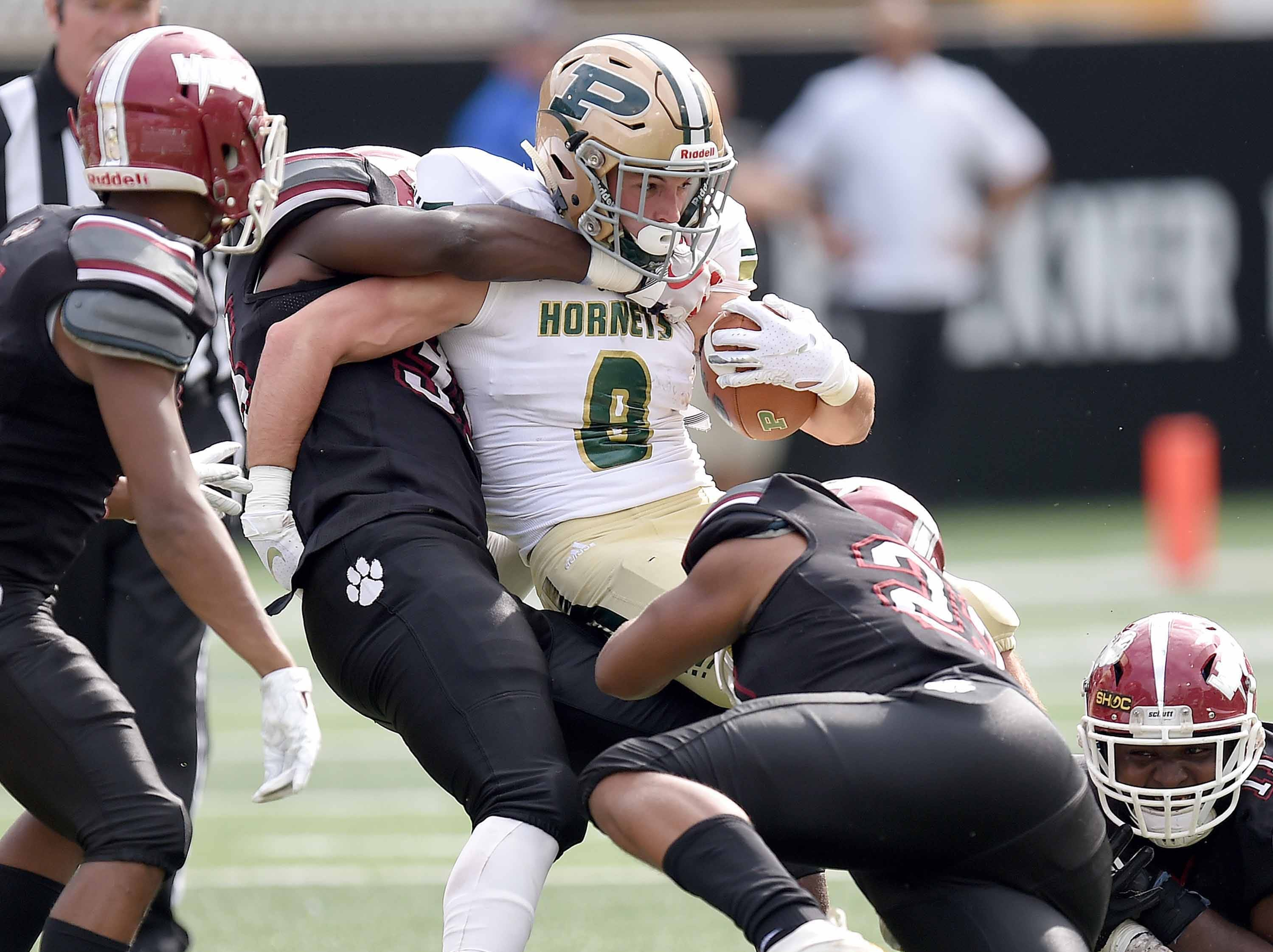 The Louisville defense gang tackle Poplarville's Tyson Holston (8) on Saturday, December 1, 2018, in the MHSAA BlueCross BlueShield Gridiron Classic High School Football Championships in M.M. Roberts Stadium on the University of Southern Mississippi campus in Hattiesburg, Miss.