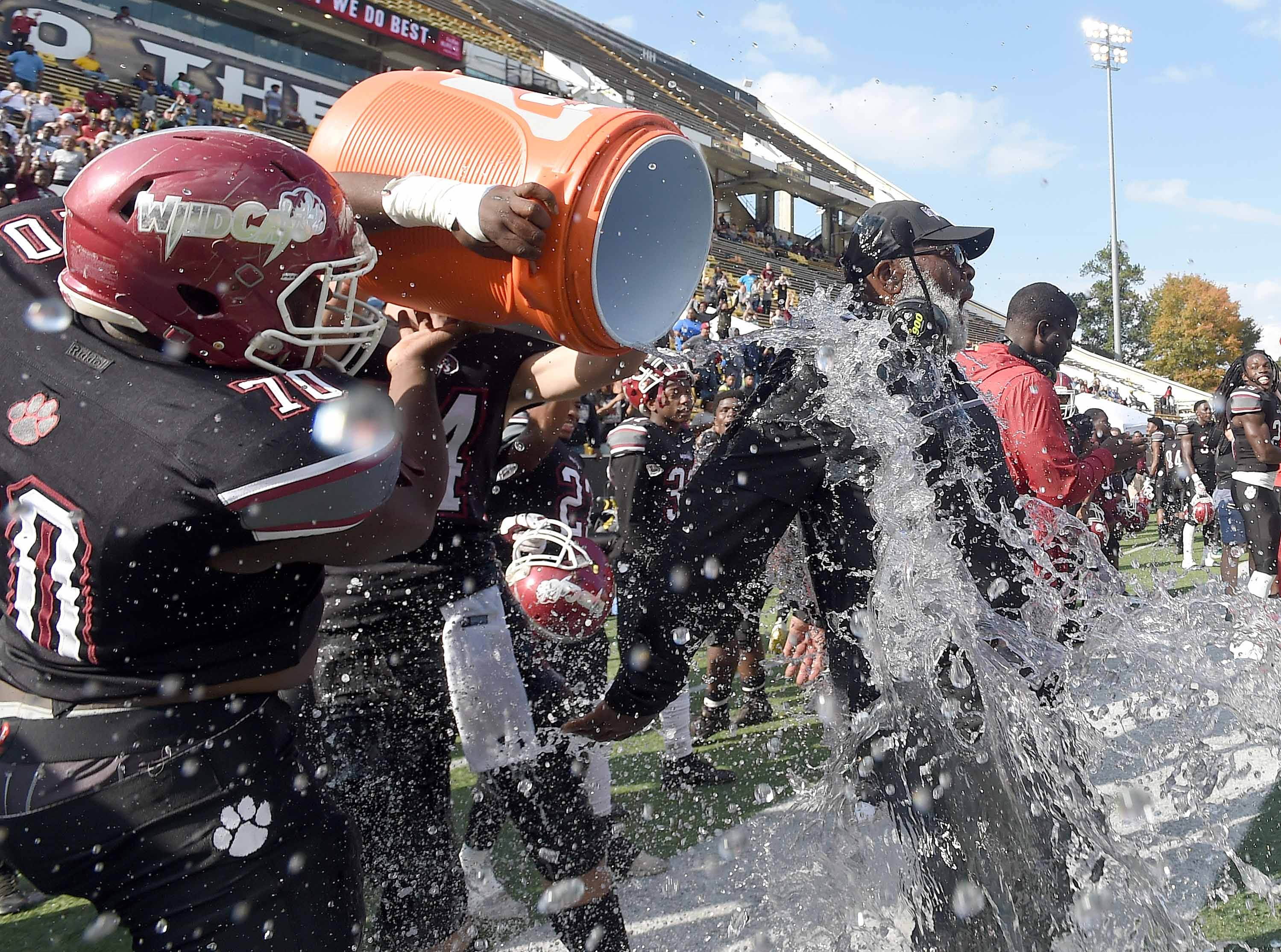 Louisville head coach M.C. Miller gets an ice water bath after the Wildcats beat Poplarville for the Class 4A title on Saturday, December 1, 2018, in the MHSAA BlueCross BlueShield Gridiron Classic High School Football Championships in M.M. Roberts Stadium on the University of Southern Mississippi campus in Hattiesburg, Miss.