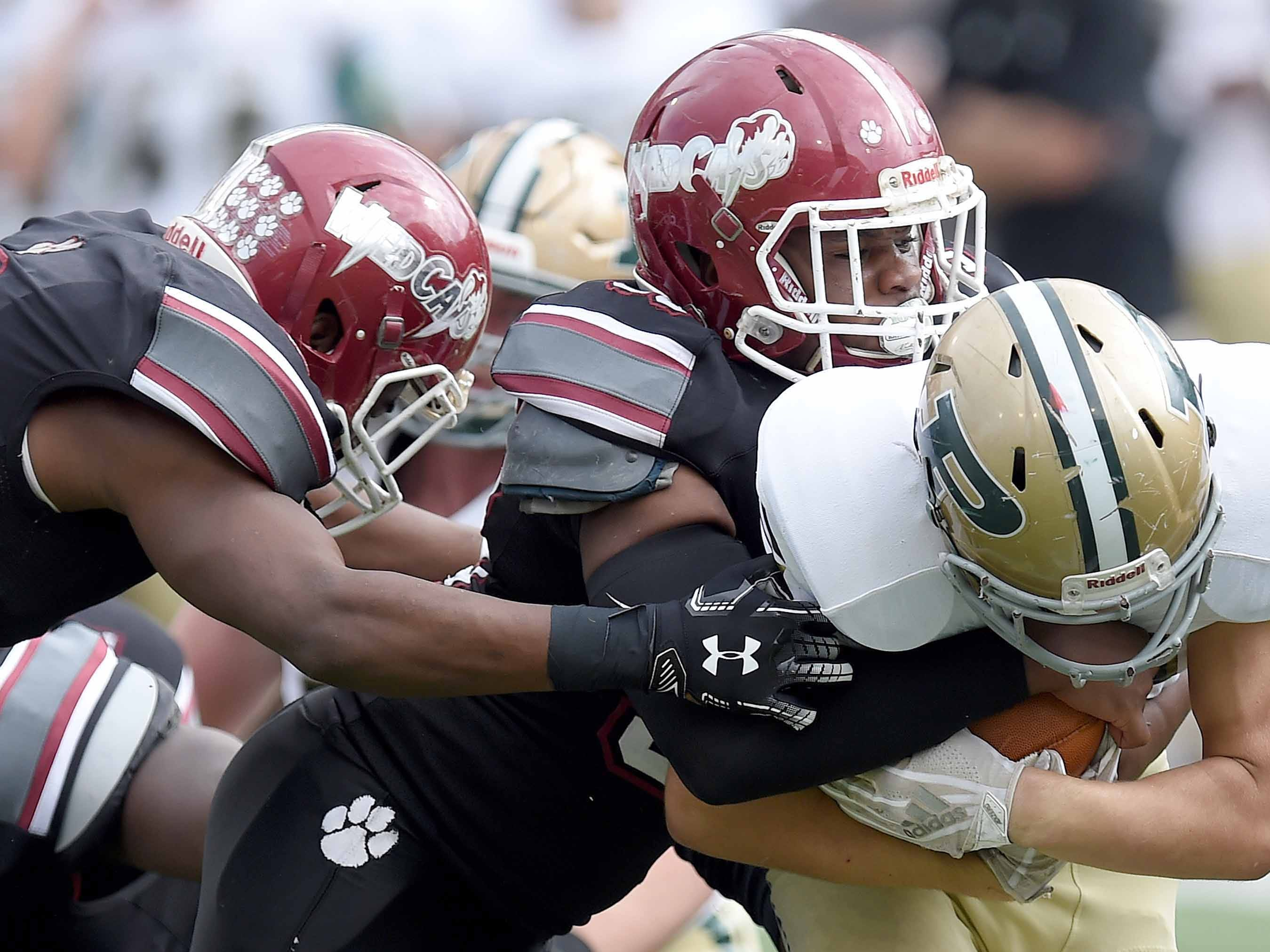 The Louisville defense tackles a Poplarville ball carrier on Saturday, December 1, 2018, in the MHSAA BlueCross BlueShield Gridiron Classic High School Football Championships in M.M. Roberts Stadium on the University of Southern Mississippi campus in Hattiesburg, Miss.