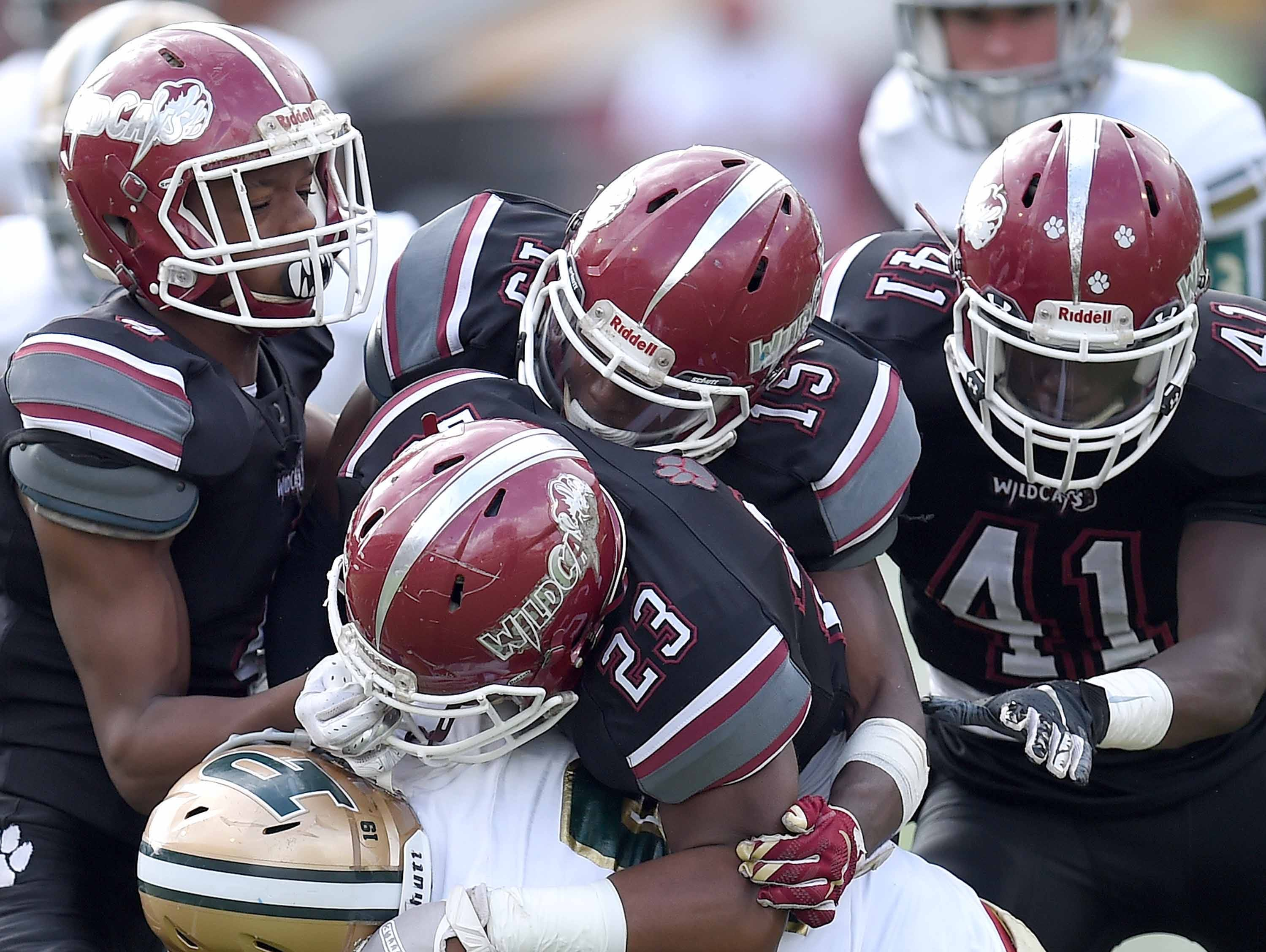 The Louisville defense swarm over a Poplarville ball carrier on Saturday, December 1, 2018, in the MHSAA BlueCross BlueShield Gridiron Classic High School Football Championships in M.M. Roberts Stadium on the University of Southern Mississippi campus in Hattiesburg, Miss.