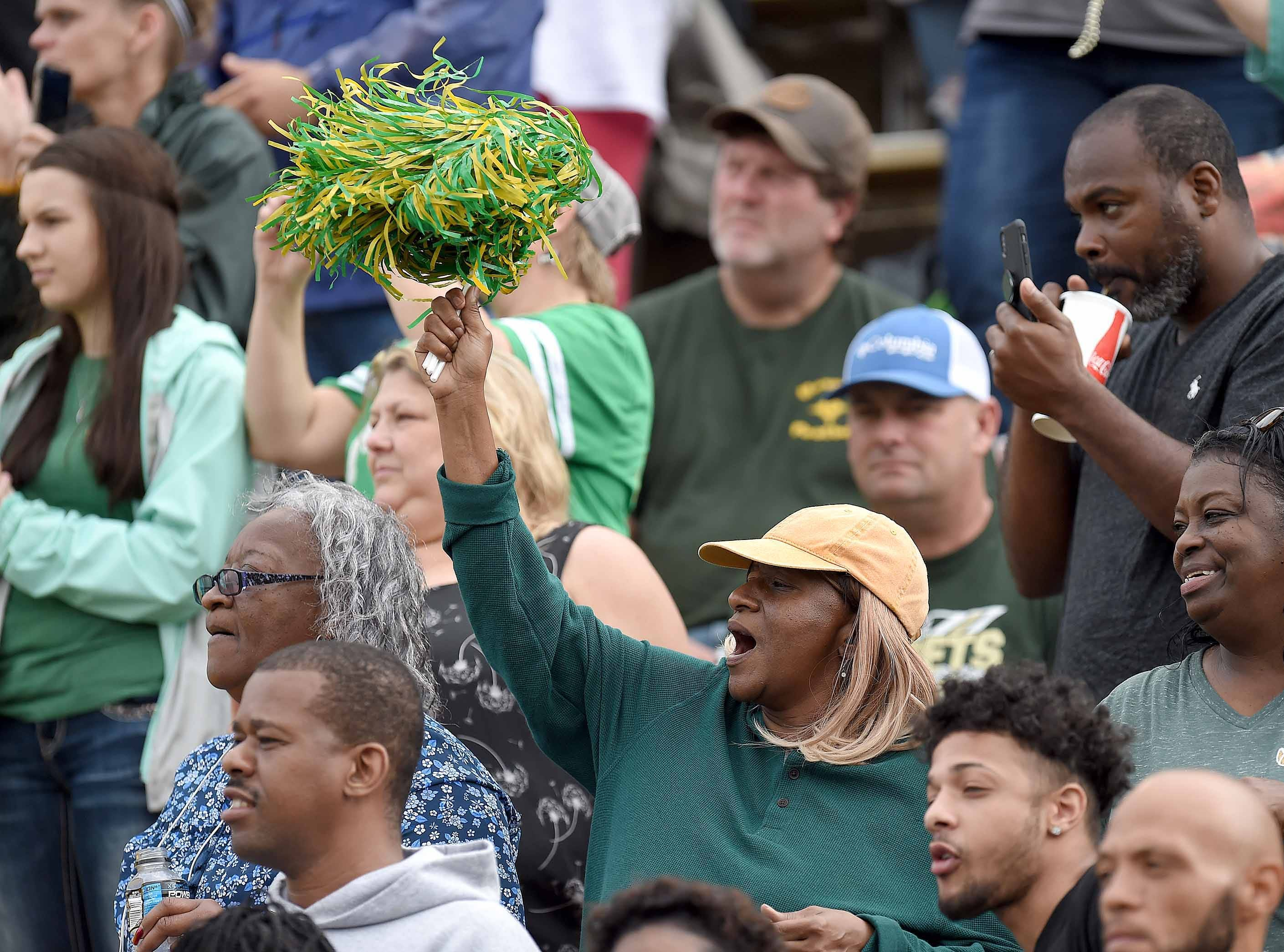 A Poplarville fan cheers for the Hornets on Saturday, December 1, 2018, in the MHSAA BlueCross BlueShield Gridiron Classic High School Football Championships in M.M. Roberts Stadium on the University of Southern Mississippi campus in Hattiesburg, Miss.