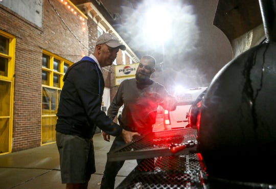 Thomas Conatser, right, walks Drew Baker through the new smoker he ordered for the restaurant he will start at 215 W Main St in Jackson, Tenn., on Friday, Nov. 30, 2018.