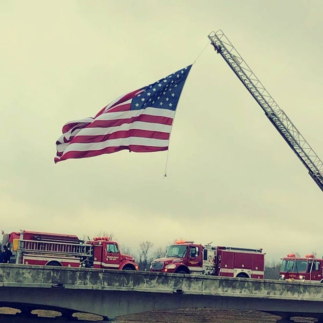 Madison County Fire Department flew a flag over the overpass at Exit 93 on I-40 on Saturday to welcome the procession bringing the body of fallen emergency worker Zach Pruitt home.