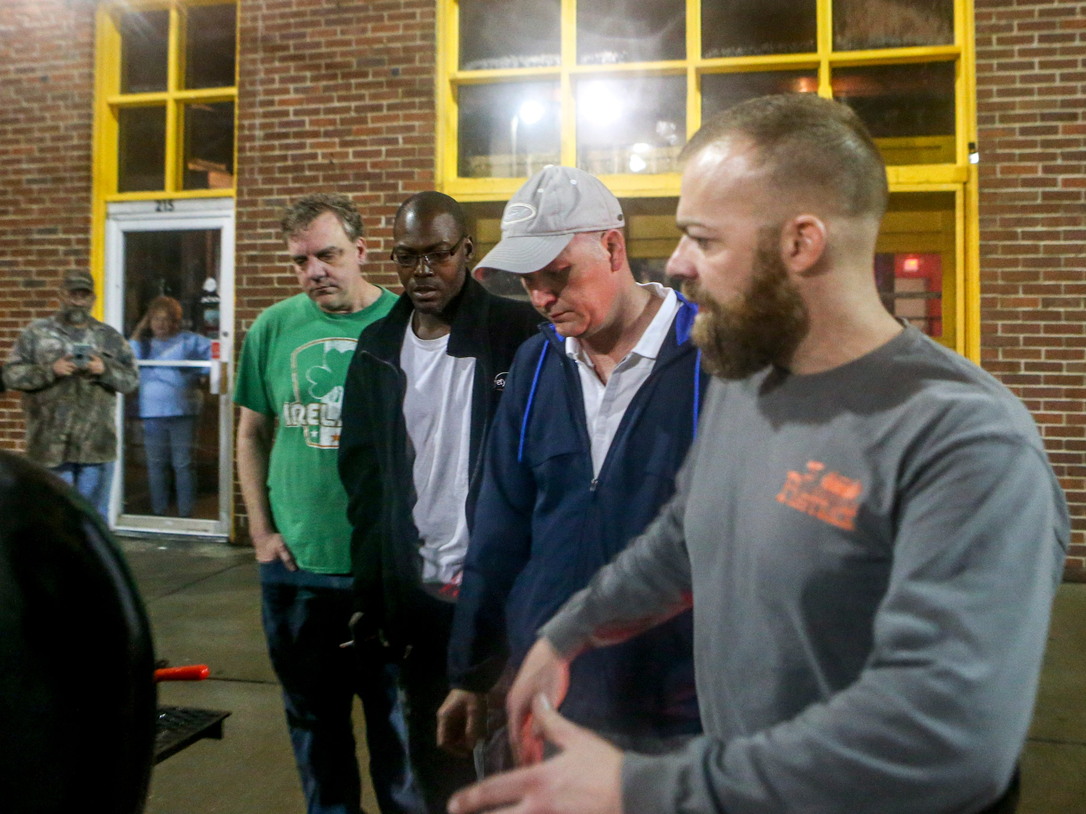 Thomas Conatser explains to Drew Baker, second right, and his team Jeffery Bond, pitmaster, second left, and Geoffrey Hale, kitchen manager, left, the new smoker for their restaurant at 215 W Main St in Jackson, Tenn., on Friday, Nov. 30, 2018.