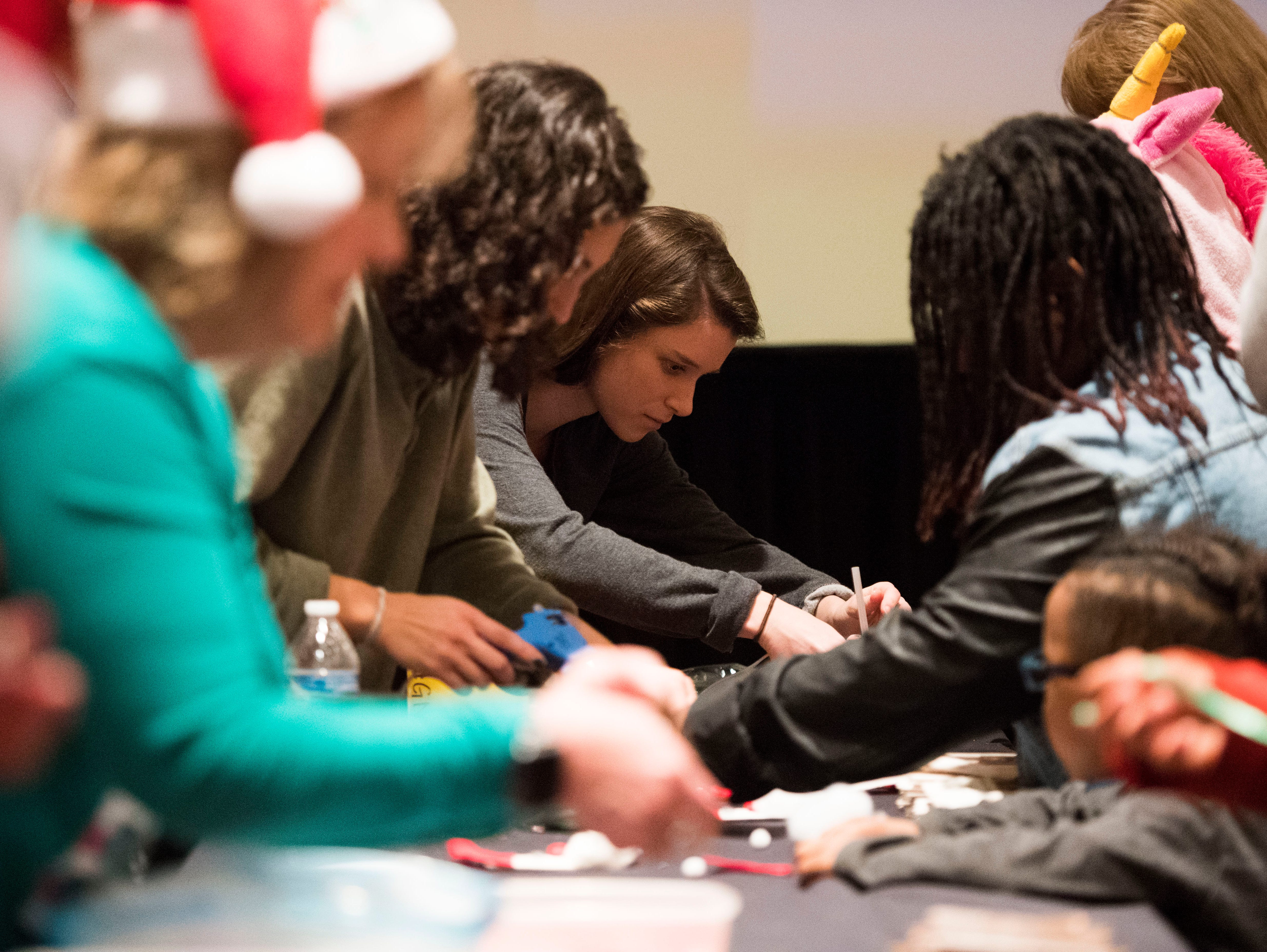 Big Brothers Big Sisters participants craft together at the Crowne Plaza for their annual holiday party Saturday, Dec. 1, 2018. Nearly 300 mentors, mentees and family members were in attendance.