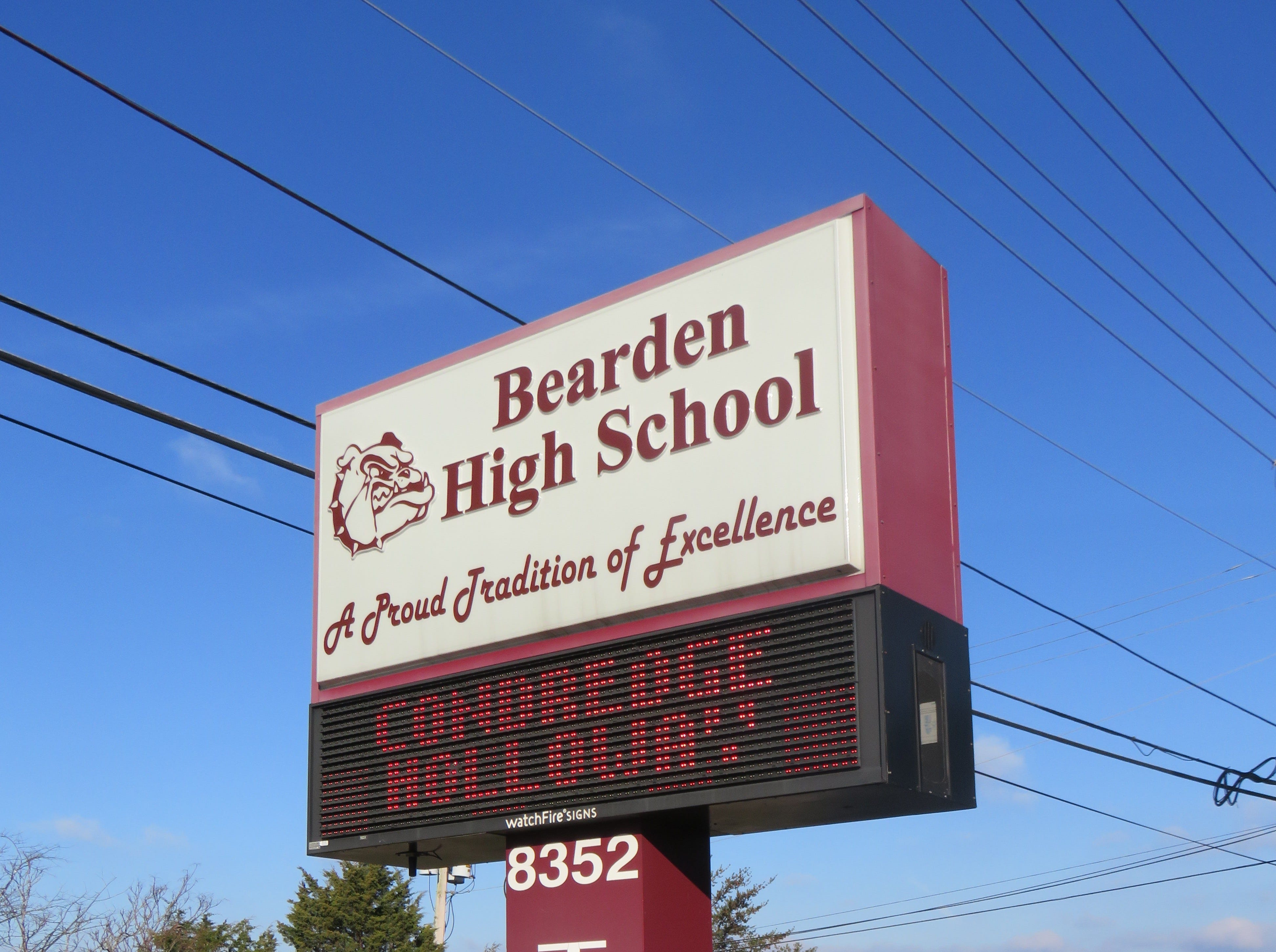 """Bearden High sign touts the school's """"Proud Tradition of Excellence""""."""