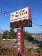 "Bearden High sign touts the school's ""Proud Tradition of Excellence""."