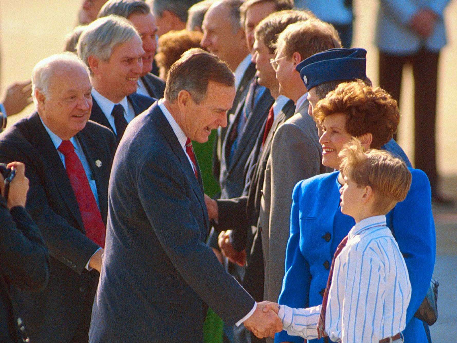 President George H.W. Bush meets John J. Duncan III, son of 2nd District Rep. John J. Duncan Jr., on Feb. 19, 1992, at McGhee Tyson Air National Guard base. Rep. Duncan's wife, Lynn, is with her son. At left are 1st District Rep. Jimmy Quillen and Rep. Duncan. The younger Duncan was elected Knox County Trustee in 2010 and served until 2013.