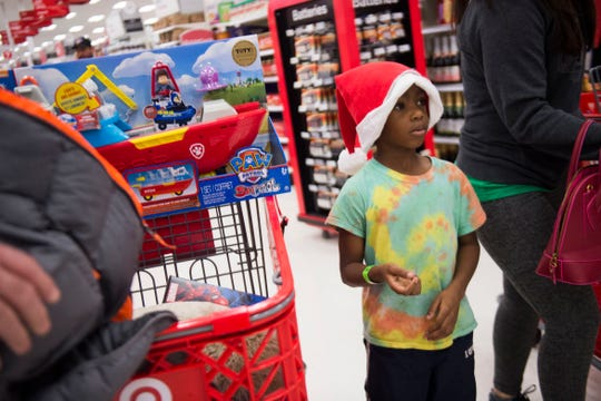 Xavier, 6, stands in line at the cash register at the Target on Clinton Highway during the annual Weigel's Family Christmas Saturday, Dec. 1, 2018. This is the 21st year Weigel's has held the shopping spree for local underprivileged children.