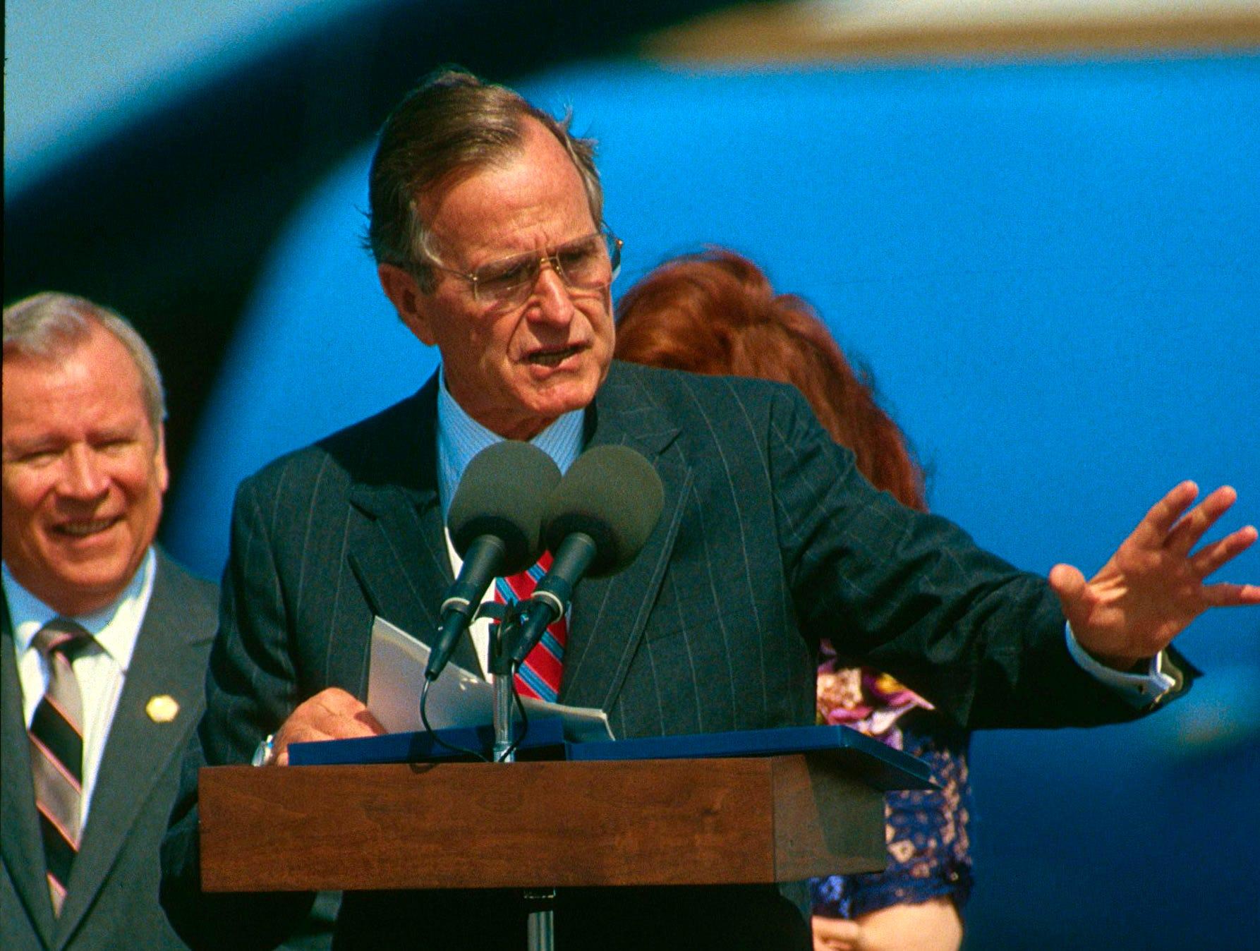 President George H.W. Bush speaks on Sept. 29, 1992, at McGhee Tyson Airport. Former U.S. Sen. Howard H. Baker Jr. is at left.