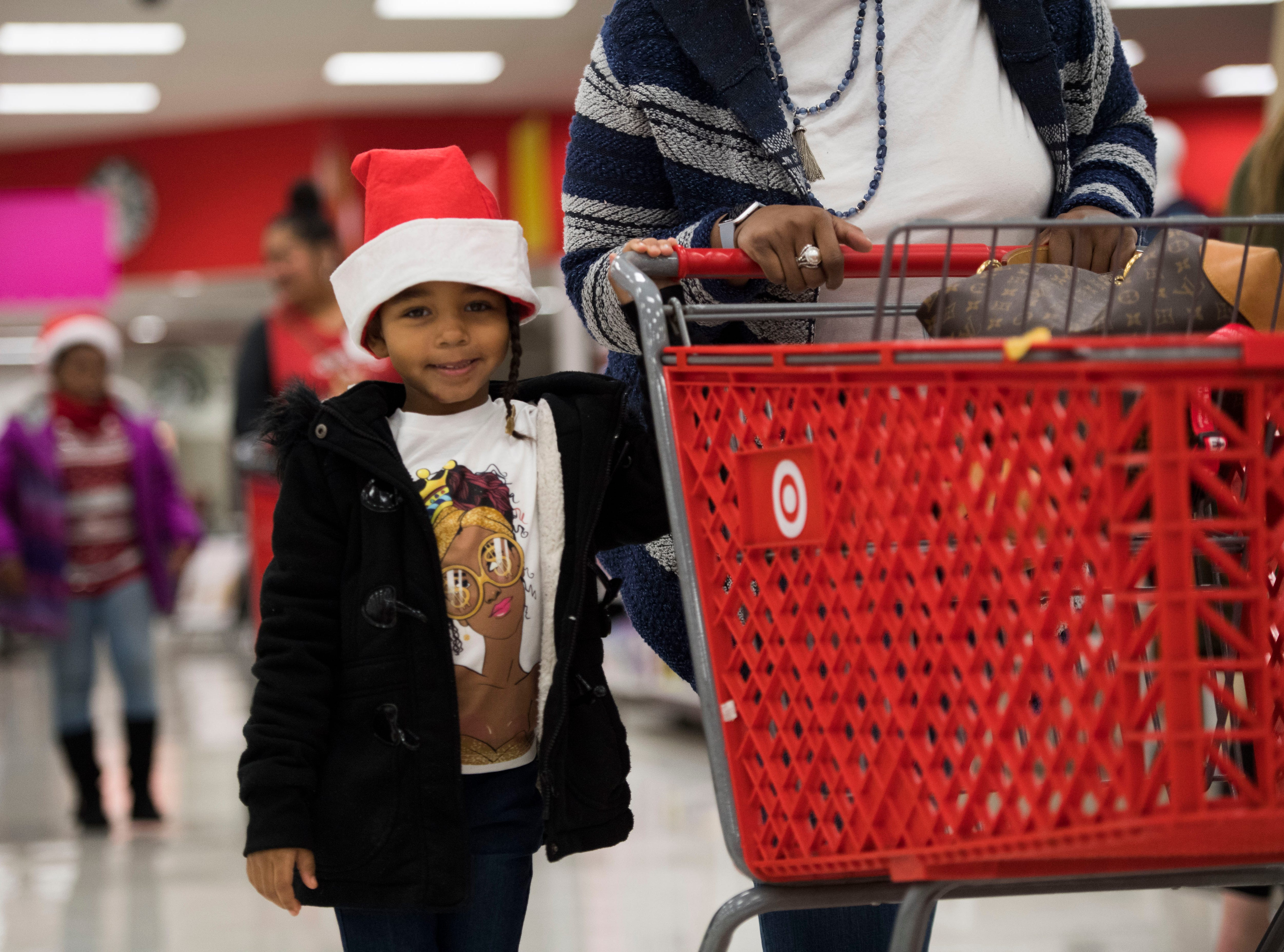 Children begin their shopping with volunteers at the Target on Clinton Highway during the annual Weigel's Family Christmas Saturday, Dec. 1, 2018. This is the 21st year Weigel's has held the shopping spree for local underprivileged children.
