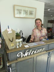Miranda Fritts stands behind the Fancy Rascal's unique checkout counter.