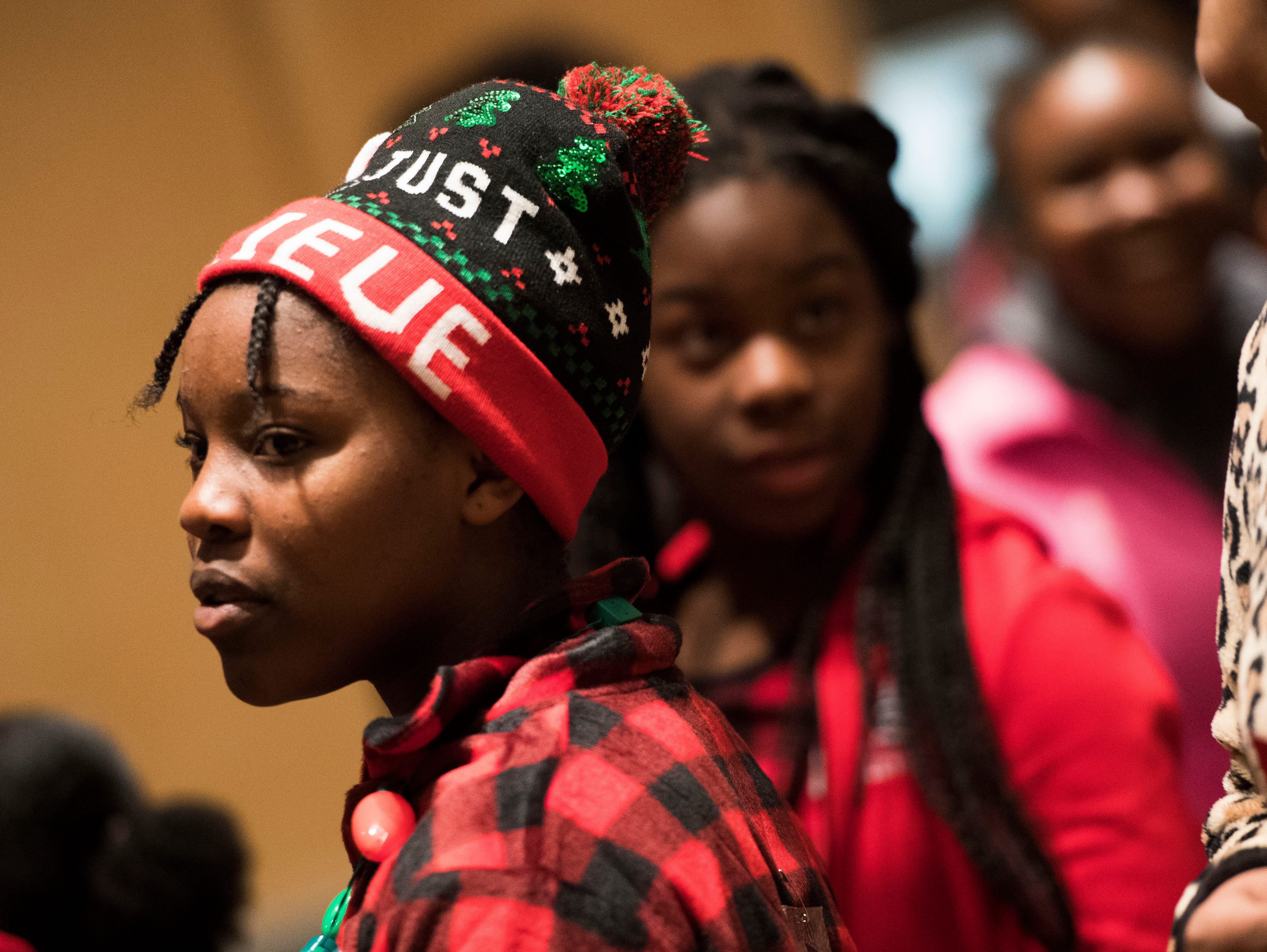 Maria Nshimirimana, 13,stands at the Big Brothers Big Sisters annual holiday party at the Crowne Plaza Saturday, Dec. 1, 2018. Nearly 300 mentors, mentees and family members were in attendance.
