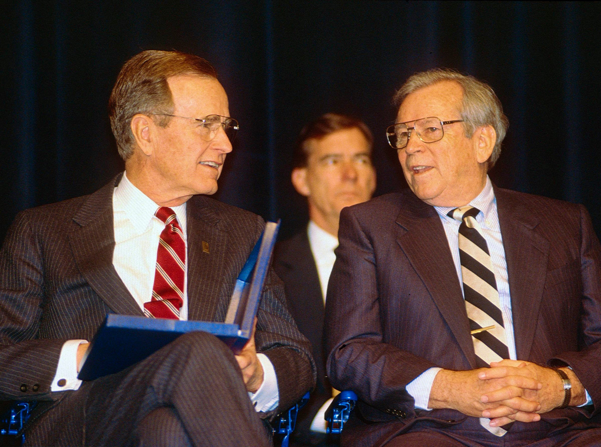 President George H.W. Bush, left, speaks with former U.S. Sen. Howard H. Baker Jr. on Feb. 19, 1992, at the Civic Auditorium. The home folks gave Baker, the President's state campaign manager, the biggest and longest standing ovation of the day.