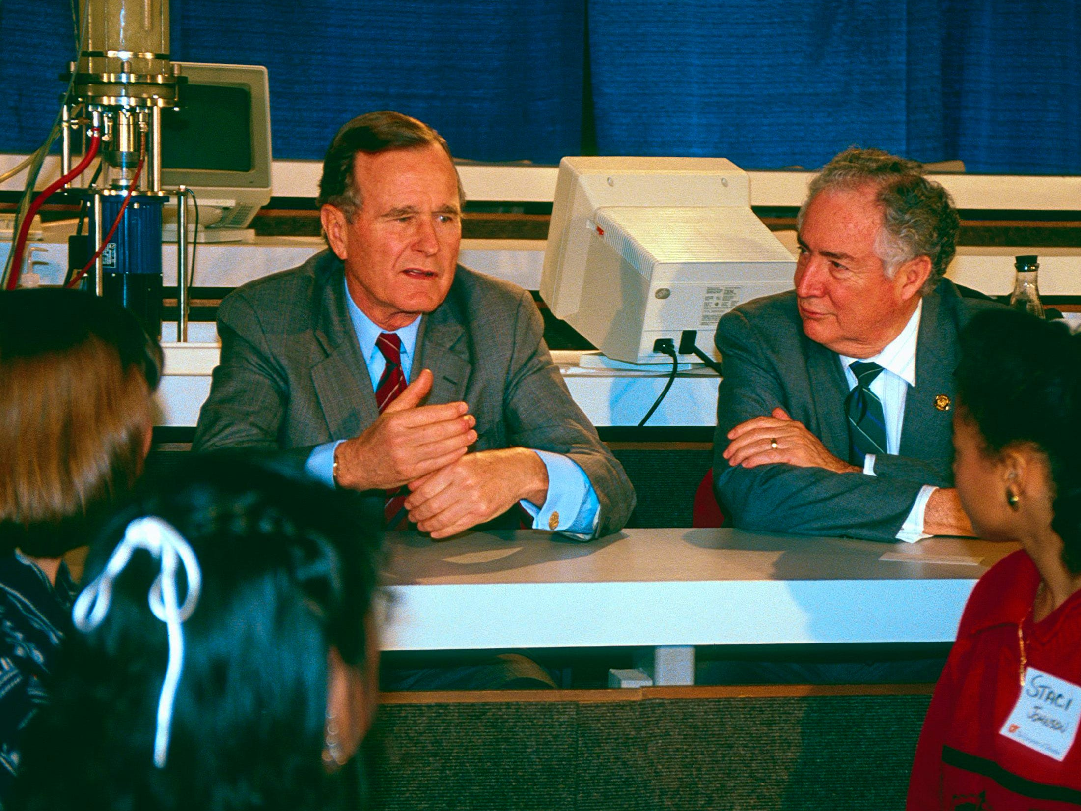 President George H.W. Bush, left, and U.S. Secretary of Education Lauro F. Cavazos engage students in discussion on Feb. 2, 1990, at the University of Tennessee. During the President's UT visit, it was announced that $3 million was being made available to start a four-week summer school for 200 of the state's top math and science teachers.