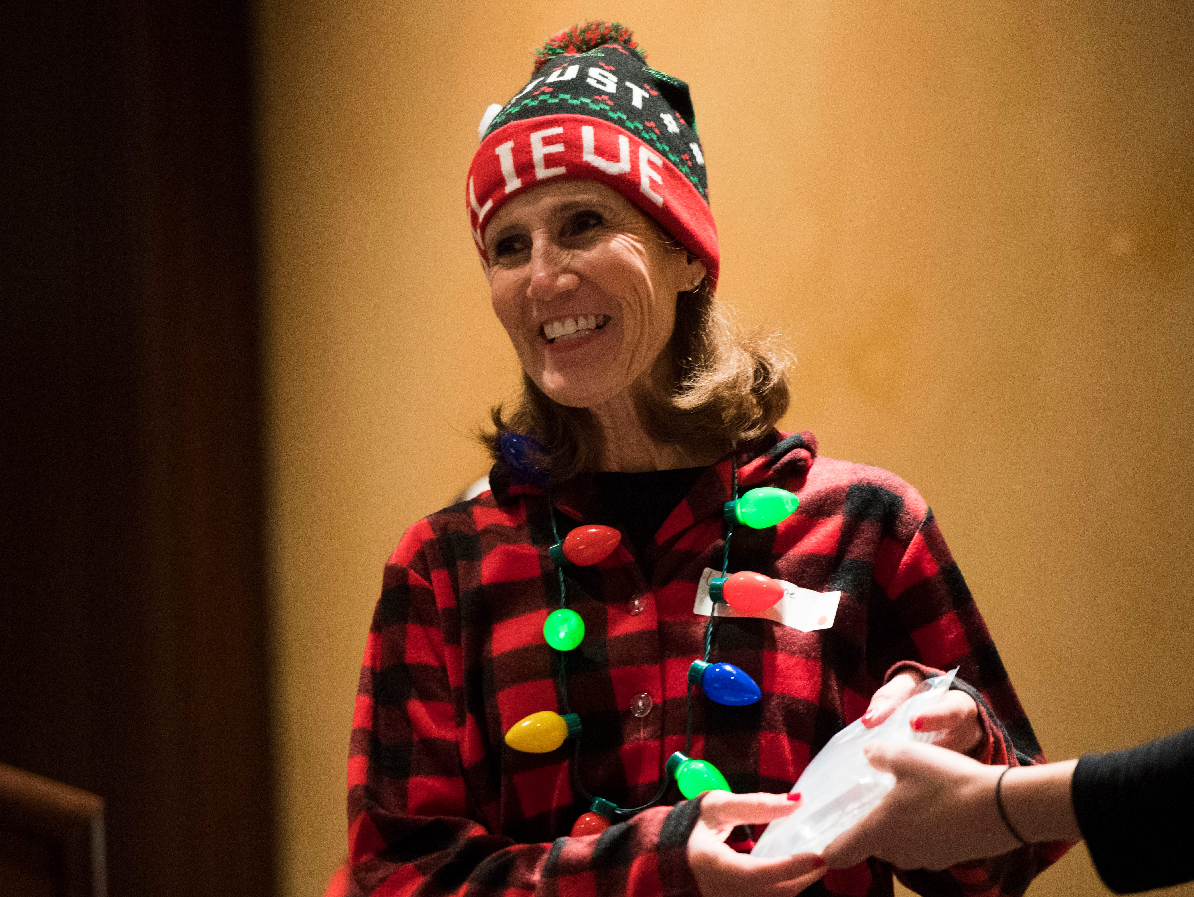 Laurie Stone, who was named Big Sister of the Year, accepts her award at the annual Big Brothers Big Sisters holiday party at the Crowne Plaza Saturday, Dec. 1, 2018. Nearly 300 mentors, mentees and family members were in attendance.
