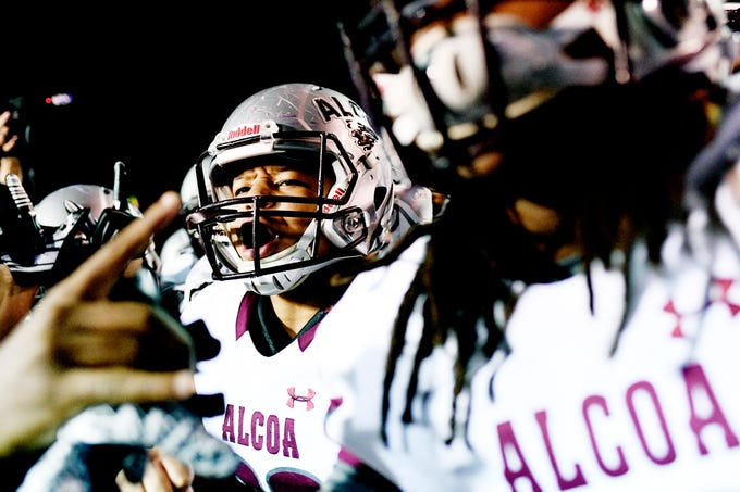 Alcoa's Tkai George (38) and C.J. Armstrong (5) celebrate their 21-14 win over Covington at the TSSAA Blue Cross Bowl at Tennessee Tech's Tucker Stadium in Cookeville, Tennessee on Saturday, December 1, 2018.