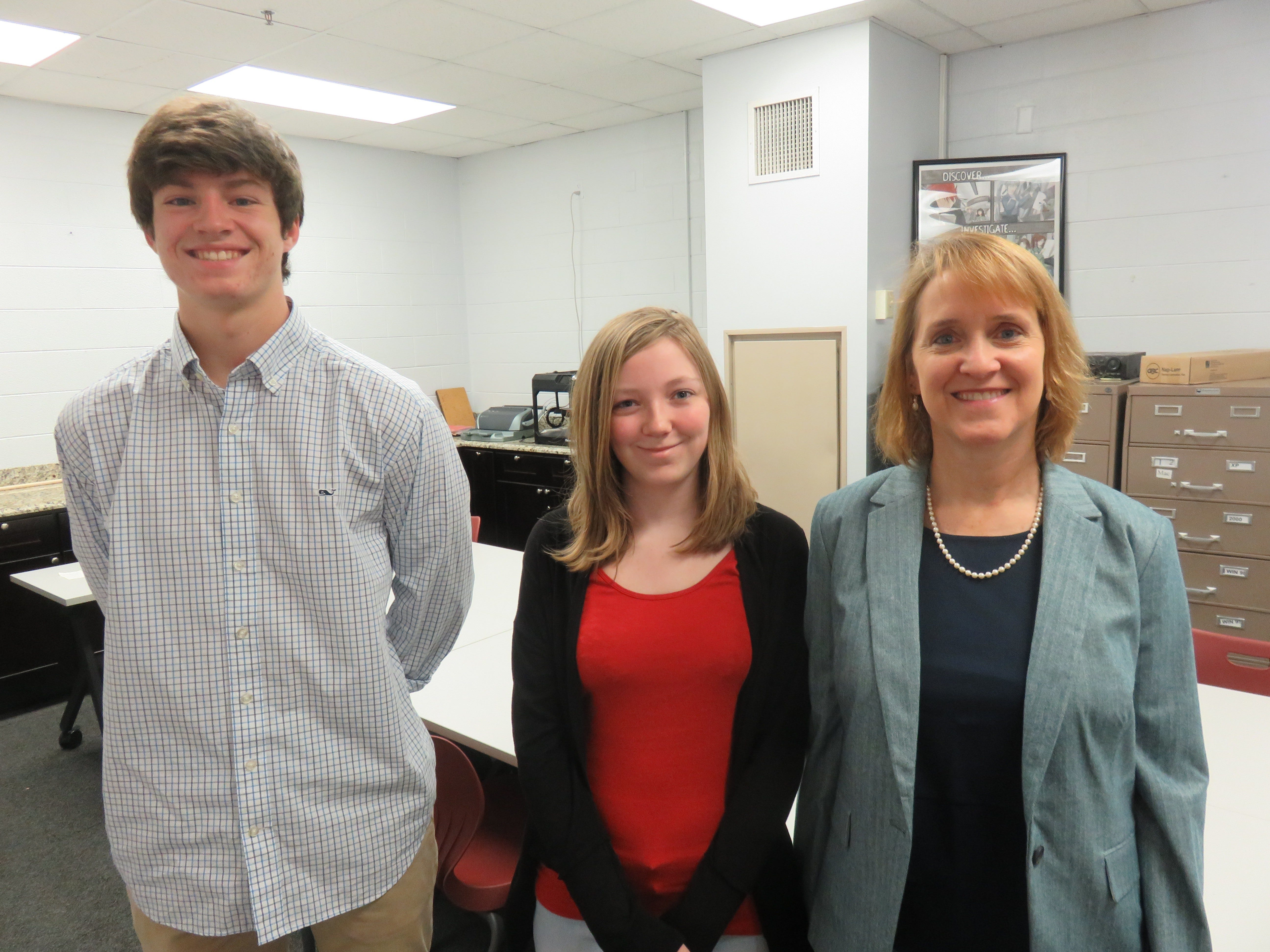 Bearden High Virtual Enterprises students Matt Carr and Chessa Runyan with teacher/facilitator Kathy McCoy, right. The class won two state championships recently in competition among other VE classes.